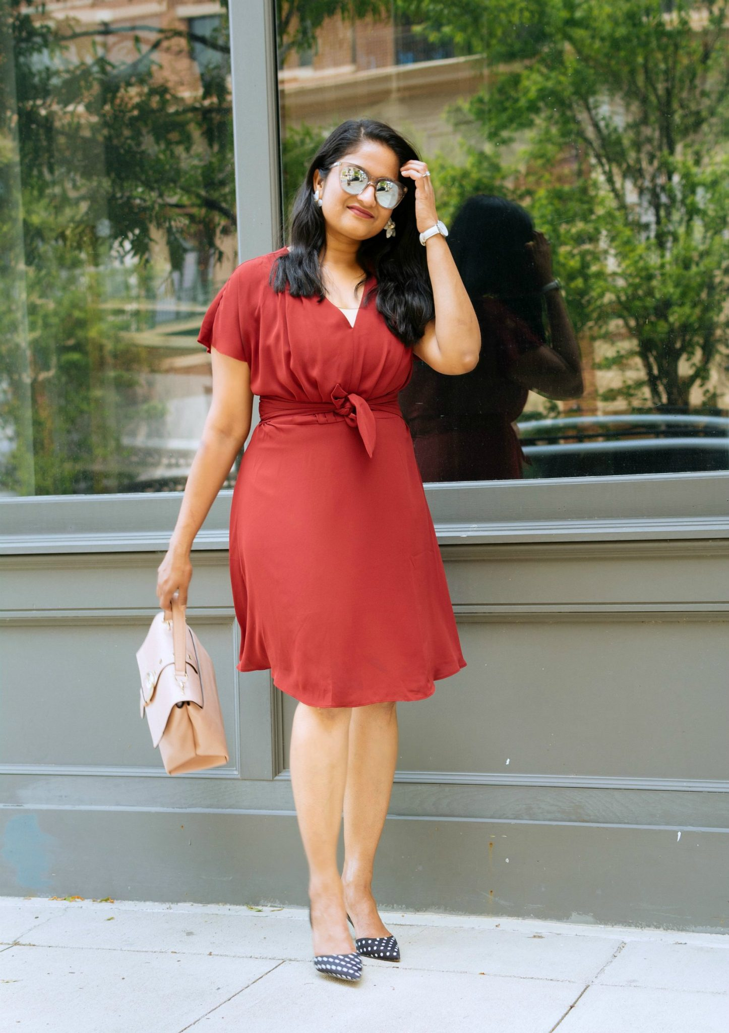 Summer office outfit ideas featured by top US modest fashion blog, Dreaming Loud: image of a woman wearing an Ann Taylor flare dress, Ann Taylor polka dot pumps, Michael Kors satchel, BAUBLEBAR flower earrings, Daniel Wellington watch, and Le Specs sunglasses