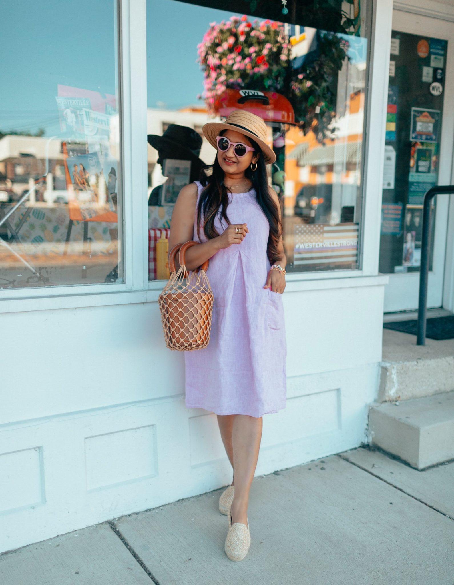Top US modest fashion blog, Dreaming Loud, features their Favorite Trendy Summer Accessories: image of a woman wearing J.jill Linen Two-Pocket Dress , Manebi Yucatan Raffia Espadrilles, STAUD Moreau Bag