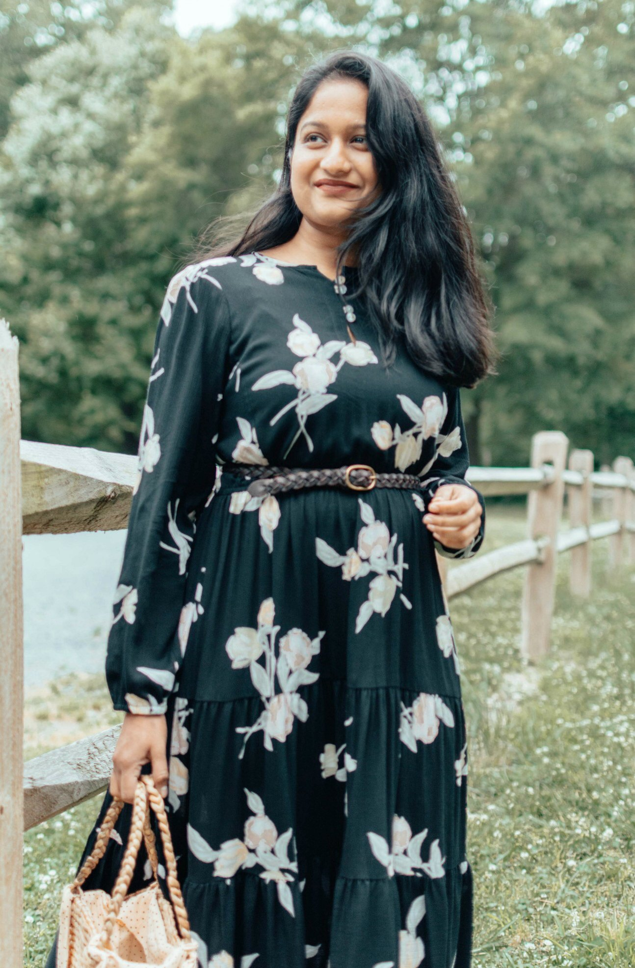 How to Feel at Home with Yourself: 5 Tips to Avoid Feeling Homesick featured by top US life and style blog, Dreaming Loud: image of a woman wearing a Christy Dawn floral dress, FAITHFULL THE BRAND Bag, Manebi raffia espadrilles