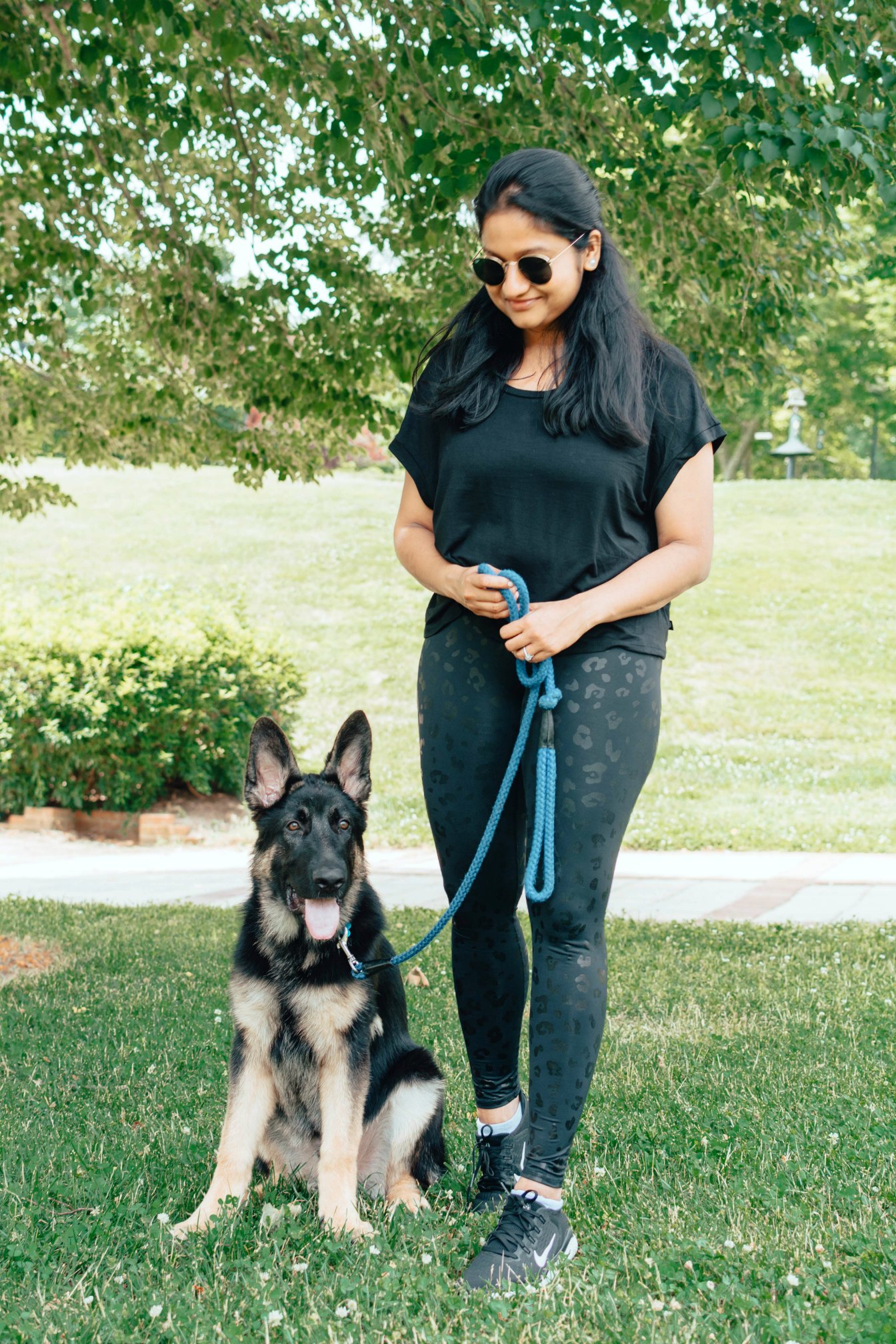 Terez Cheetah Foil Legging featured by top US modest fashion blog, Dreaming Loud: image of a woman with her pet in the park