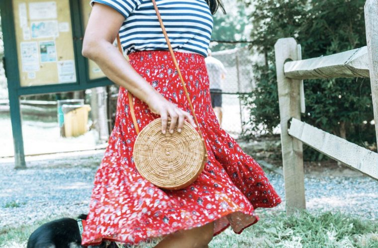 5 Cute Fourth of July Outfits to Celebrate Independence Day in Style featured by top US modest fashion blog, Dreaming Loud: image of a woman wearing St. John's Bay Womens Elastic Waist Midi Pleated Skirt, Everlane striped box tee, Steve Madden Kataryna Sandal