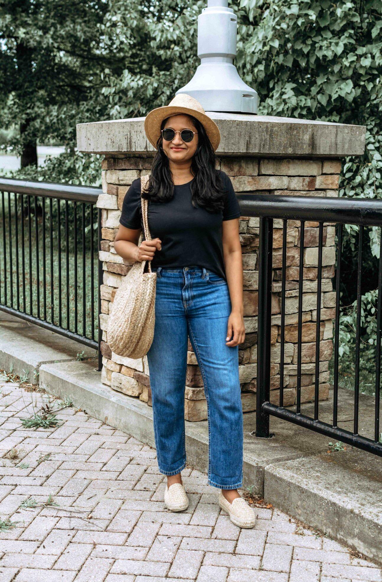 Wearing Everlane summer jeans, Cotton Box-Cut Tee, Manebí Yucatan Raffia Espadrilles, Straw circle bag and straw hat 1