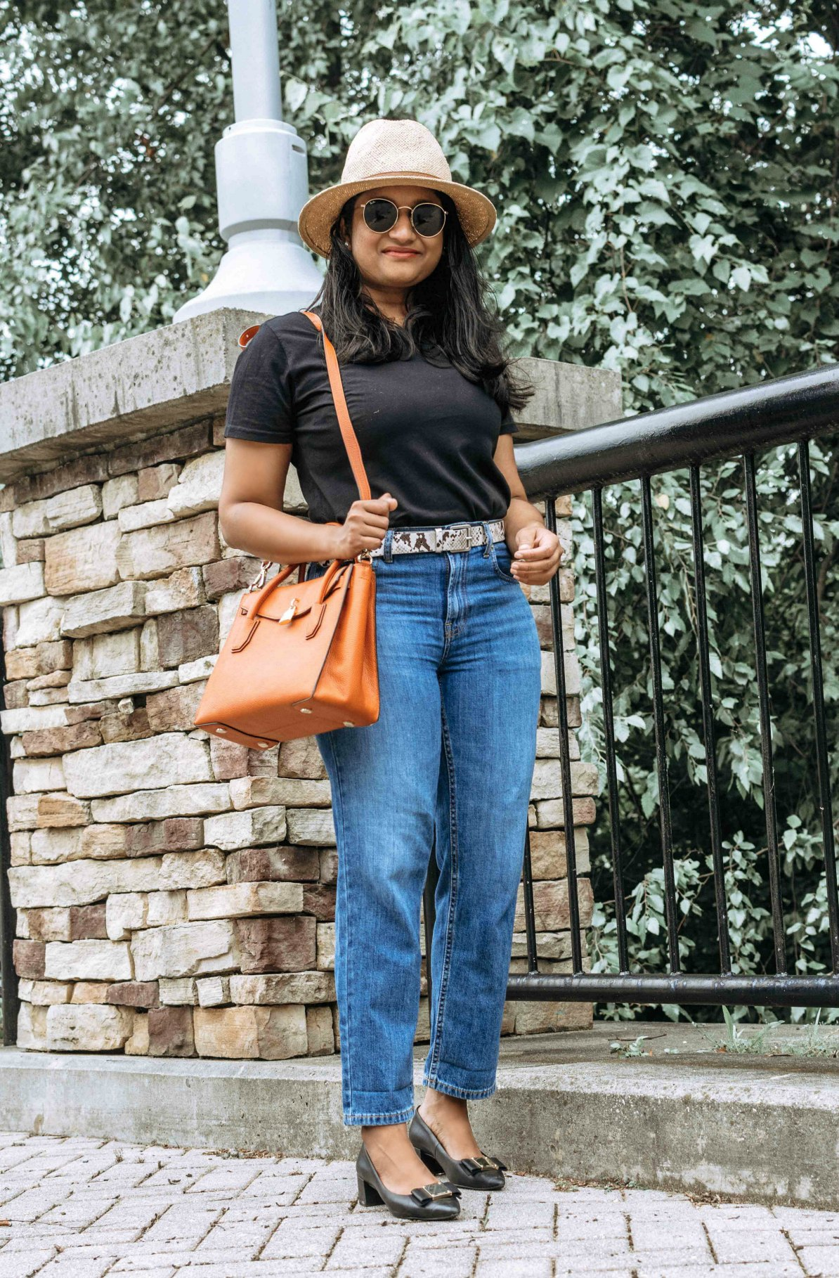 How to wear a black tee and jeans, styling tips featured by top US modest fashion blog, Dreaming Loud: image of a woman wearing Everlane summer jeans, Cotton Box-Cut Tee, belt bag, Snake Embossed Faux Leather Belt, Cole Haan Tali Block-Heel Pumps 4