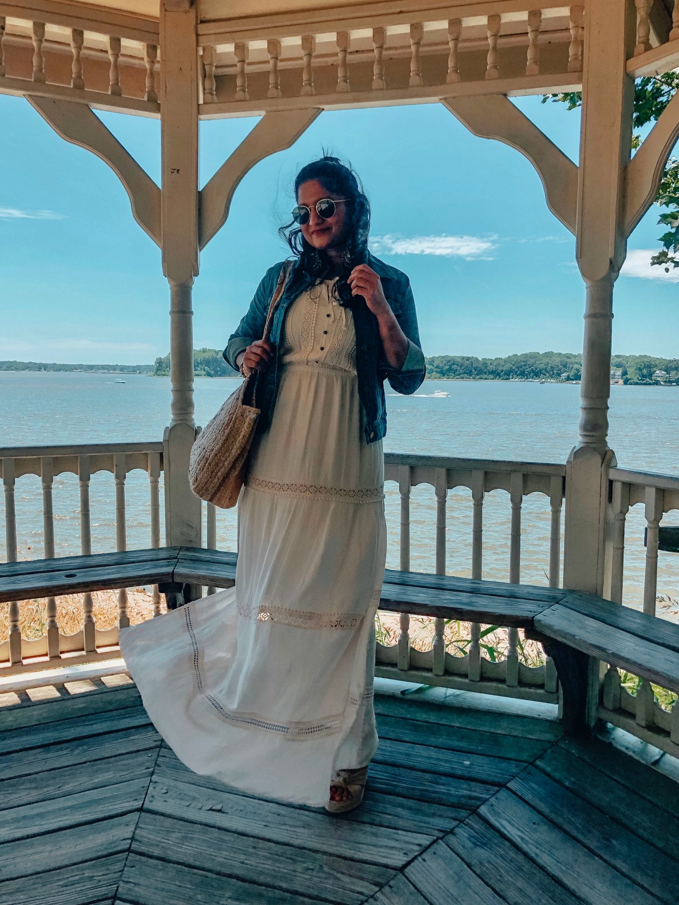 5 Cute Fourth of July Outfits to Celebrate Independence Day in Style featured by top US modest fashion blog, Dreaming Loud: image of a woman wearing American Eagle AE LACE TRIM MAXI DRESS, Madewell denim jacket, frye wedges.jpg 1