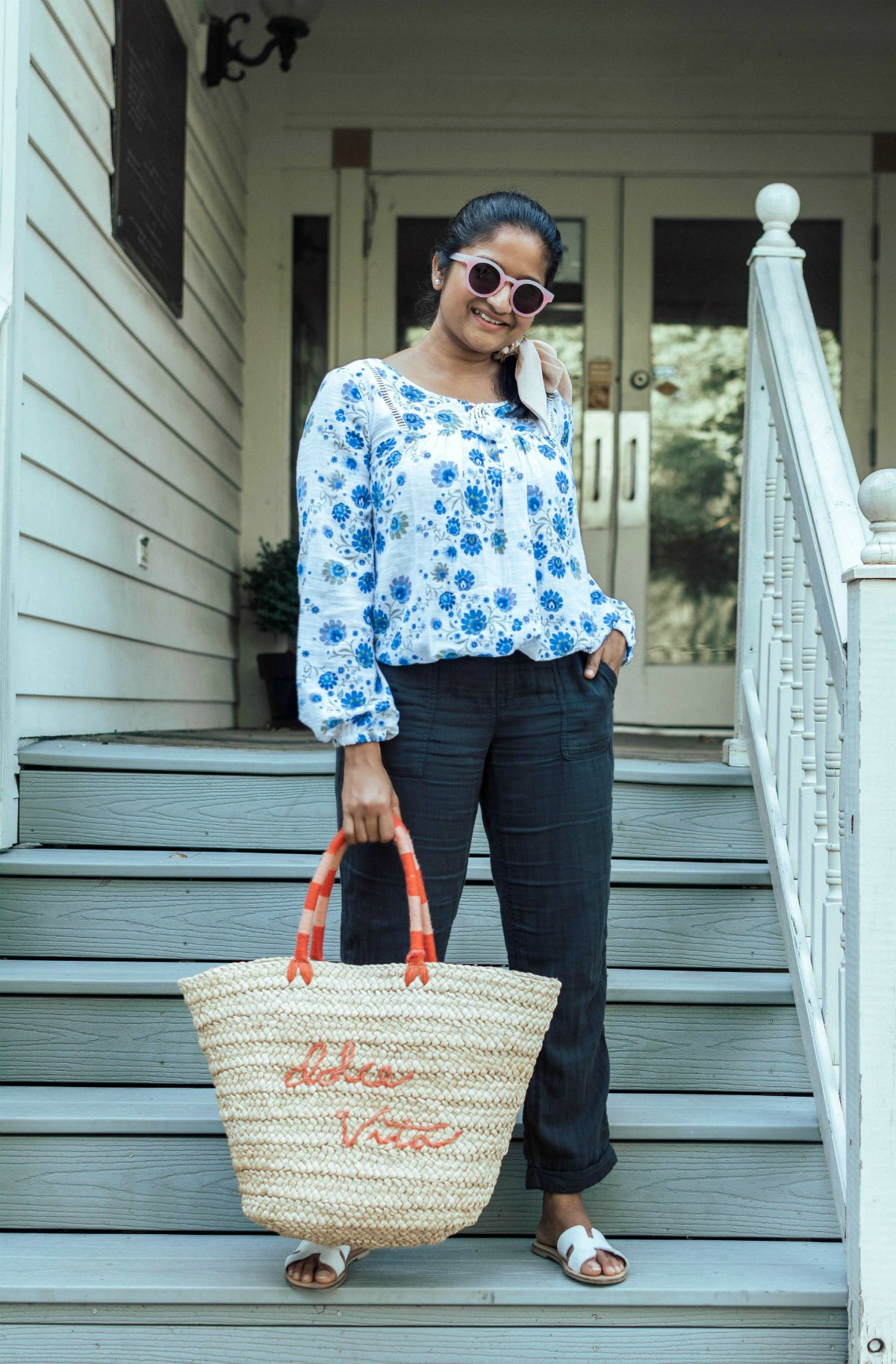 Summer Essentials for Women featured by top US modest fashion blog, Dreaming Loud: image of a woman wearing a Sofia Jeans By Sofia Vergara Boho Peasant Tassel Longsleeve Top, Old navy linen Mid-Rise Soft Twill Pull-On Utility Pants, Steven Greece Sandal, dolce vita straw tote