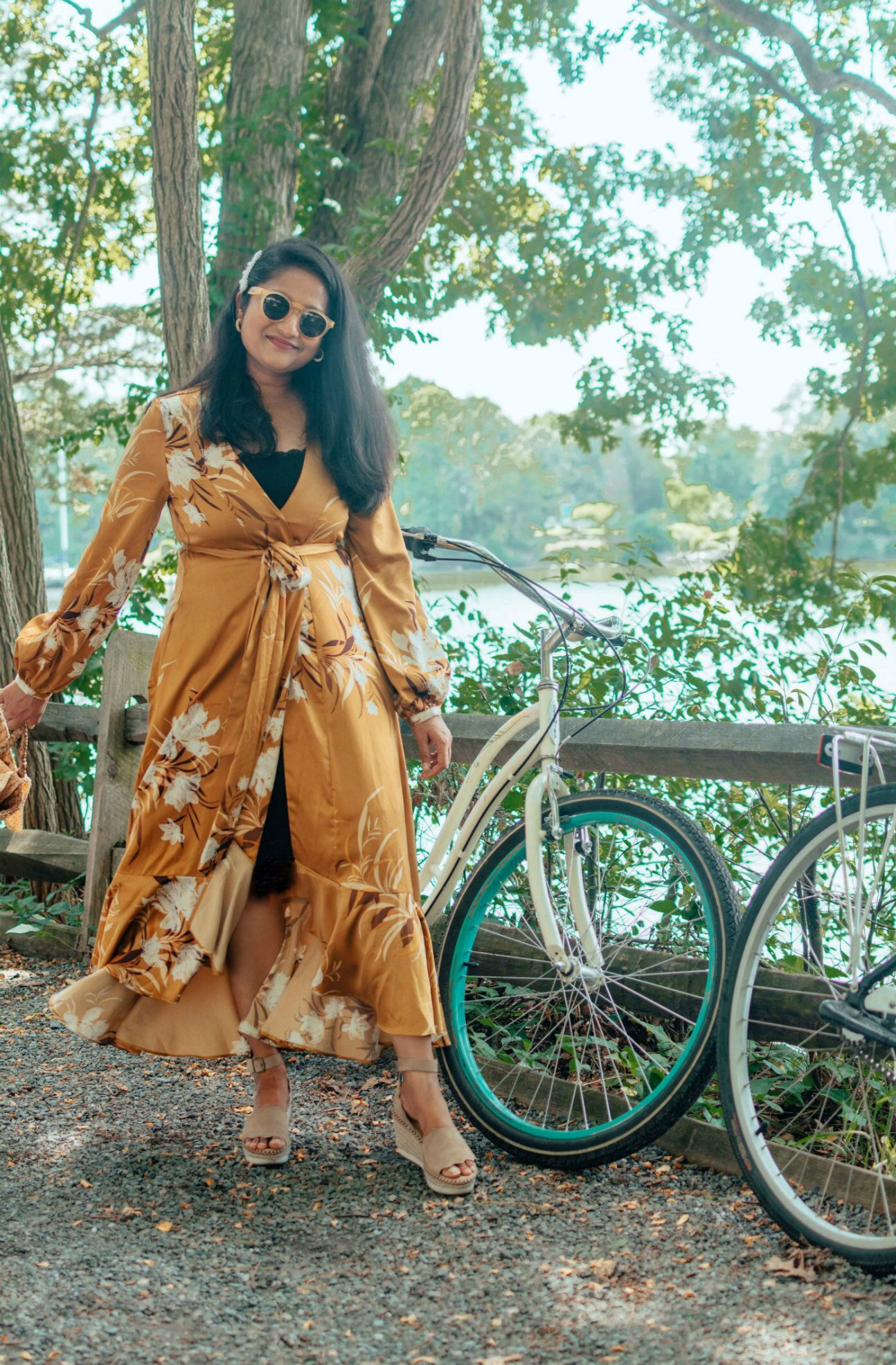 Modest Summer Wedding Guest Dresses featured by top US modest fashion blog, Dreaming Loud: image of a woman wearing an Express floral kimono dress, Peekaboo Chic slip dress, Crow Vintage wedge espadrille sandals, BAUBLEBAR studded hoop earrings.