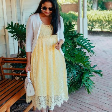 Modest Summer Wedding Guest Dresses featured by top US modest fashion blog, Dreaming Loud: image of a woman wearing an H&M lace dress, Castaner wedge espadrilles, Kelly & Katie crossbody boat, J Crew factory cardigan, and Baublebar heart drop earrings.