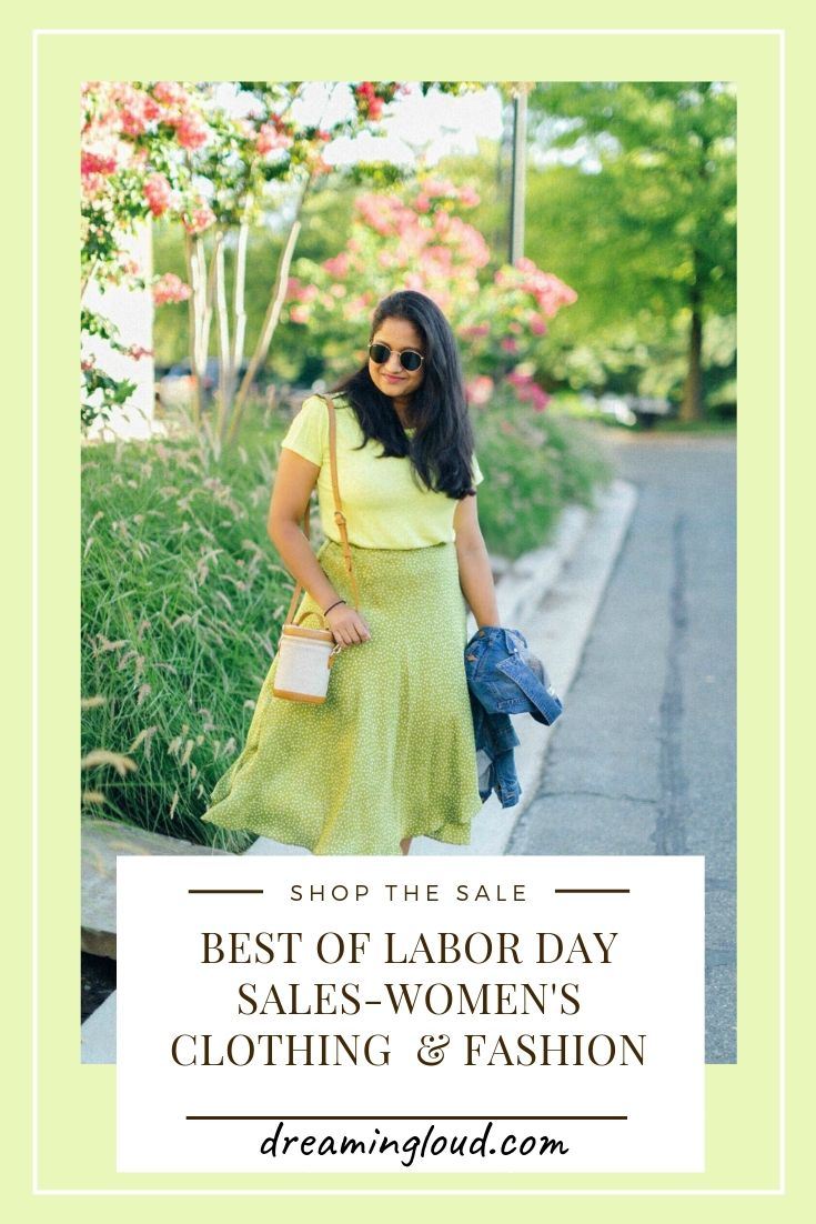 Best Labor Day Sales-Women's Clothing & Fashion by popular fashion blog, Dreaming Loud: image of a woman standing outside under a tall flowering bush and wearing a green shirt, green skirt, and holding a jean jacket.