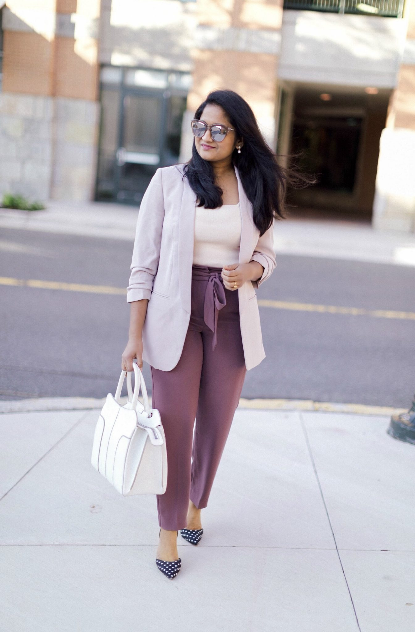 4 Ways to Wear a Light Pink Blazer to the Office featured by top US modest fashion blog, Dreaming Loud: image of a woman wearing Express high waisted sash tie ankle pant, Express ruched sleeve boyfriend blazer,Leith Square Neck Sleeveless Sweater, Tod's contrast trim tote - White,Le specs Half Moon Magic Sunglasses,Polka Dot Slingback Pumps