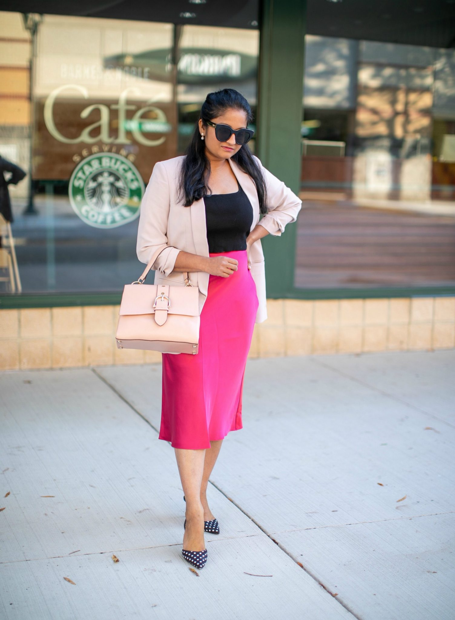wearing Club monacp Trycia Satin Skirt in pink, express ruched sleeve boyfriend blazer in petal pink, polka dot pumps, pink stachel