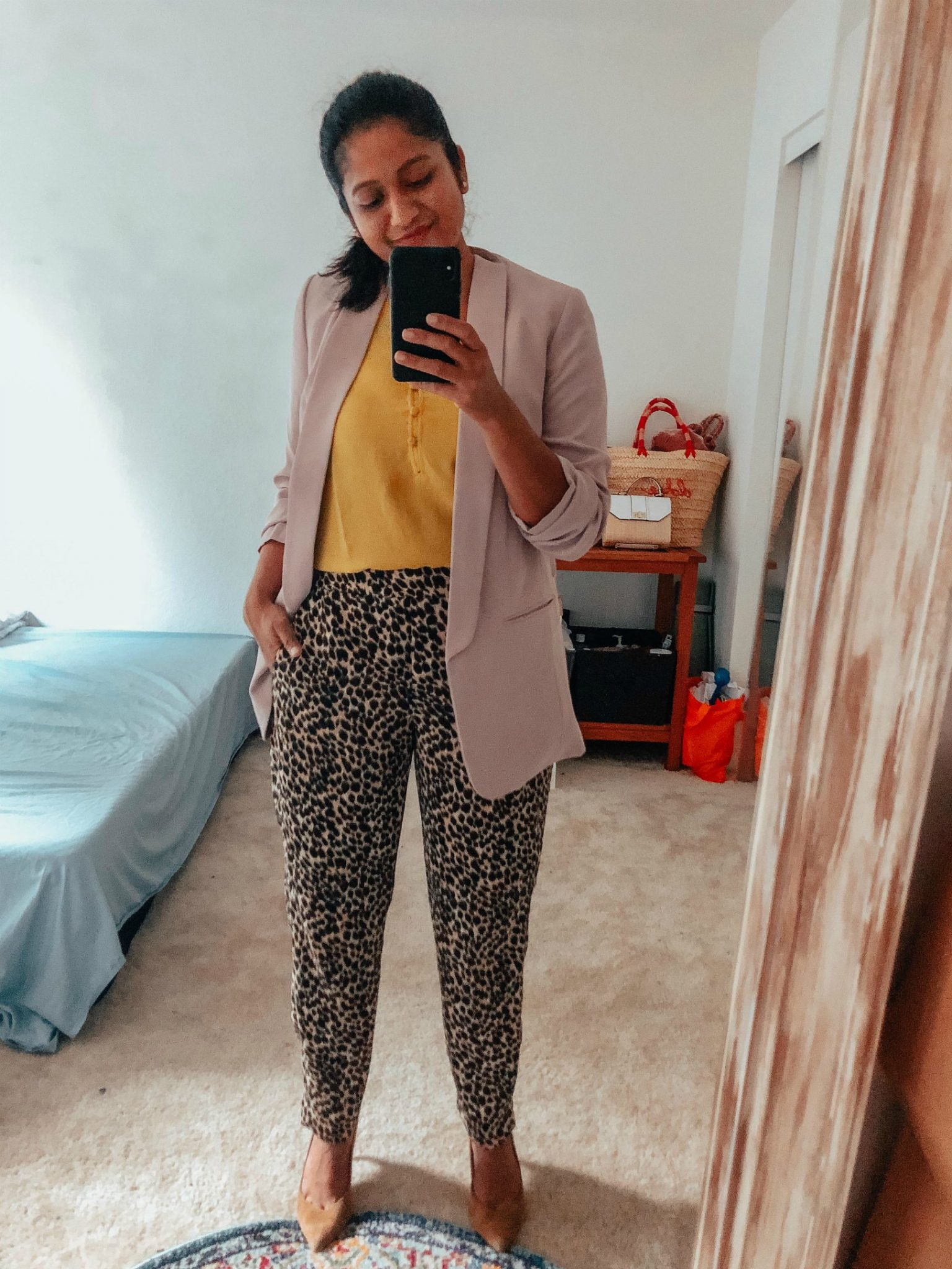 4 Ways to Wear a Light Pink Blazer to the Office featured by top US modest fashion blog, Dreaming Loud: image of a woman wearing jcrew factory leopard print Jamie pant, express ruched sleeve boyfriend blazer in petal pink, banana republic Madison 12-Hour Pump
