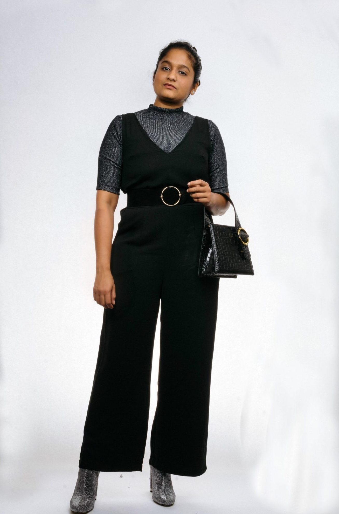 How to wear an all black outfit in the Spring, fashion tips featured by top US modest fashion blog, Dreaming Loud: image of a woman Wearing wearing target black jumpsuit, Micheal kore sequin booties, Parisa Wang PARISA WANG Enchanted Croc-Embossed Satchel