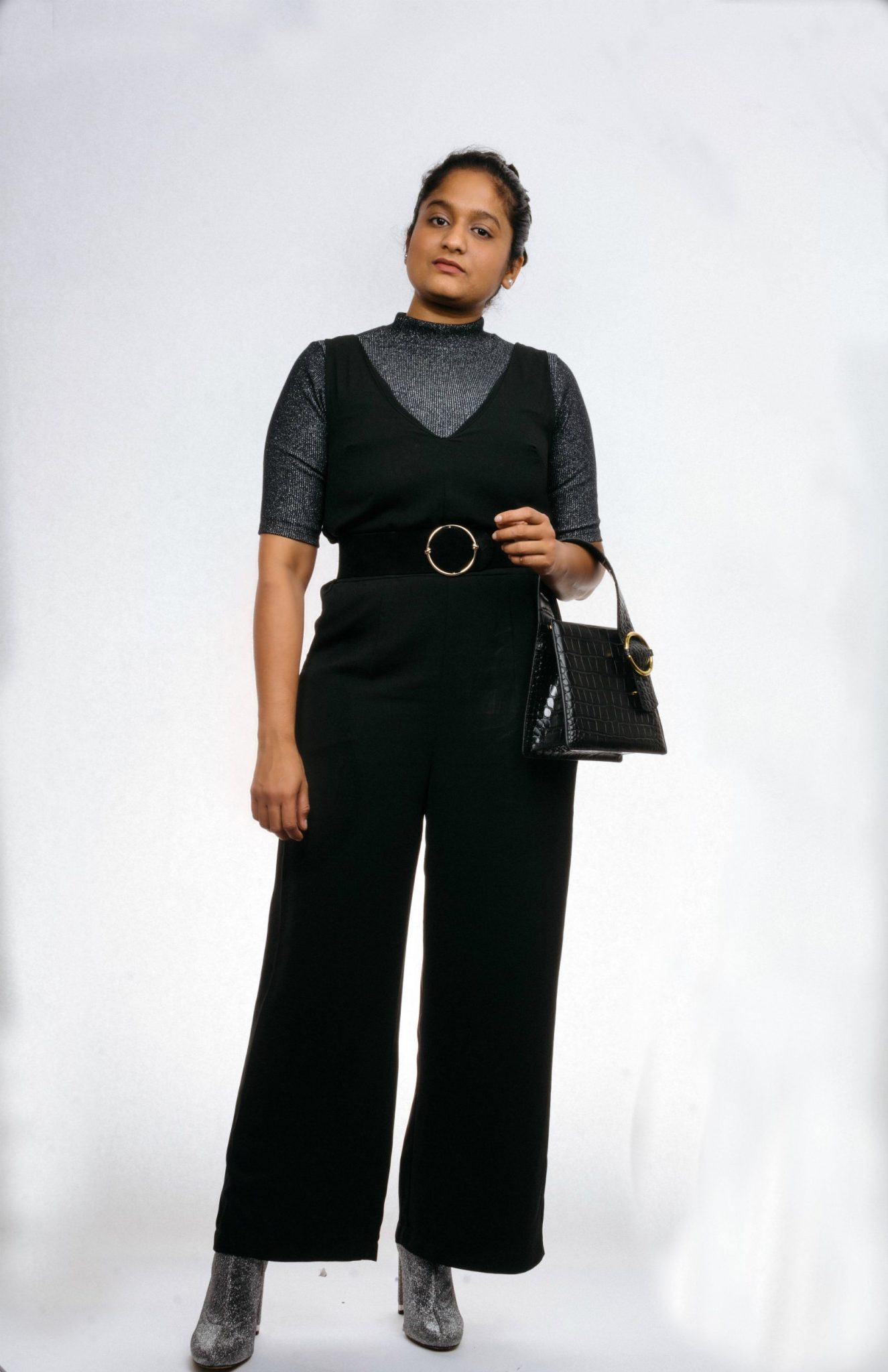 How to Take your Workwear Pieces from Day to Night featured by top US modest fashion blog, Dreaming Loud: image of a woman wearing target black jumpsuit, Micheal kore sequin booties, Parisa Wang PARISA WANG Enchanted Croc-Embossed Satchel