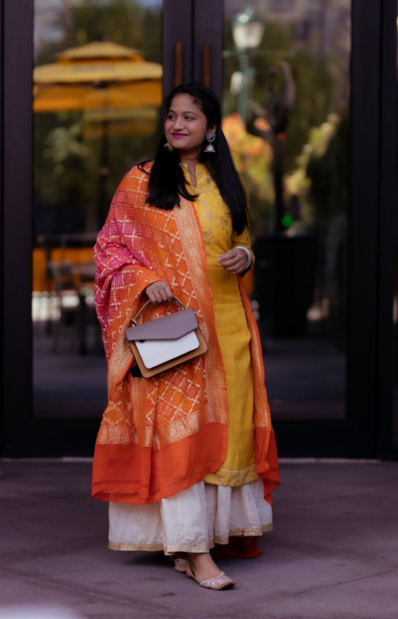 5 Cute Diwali Outfits to Wear for your Diwali Party, Diwali look book featured by top US modest fashion blog, Dreaming Loud: yellow kurtha, beige gold skirt,Bandhani dupatta, Botkier Cobble Hill Color-Block Crossbody, silver jhumkas