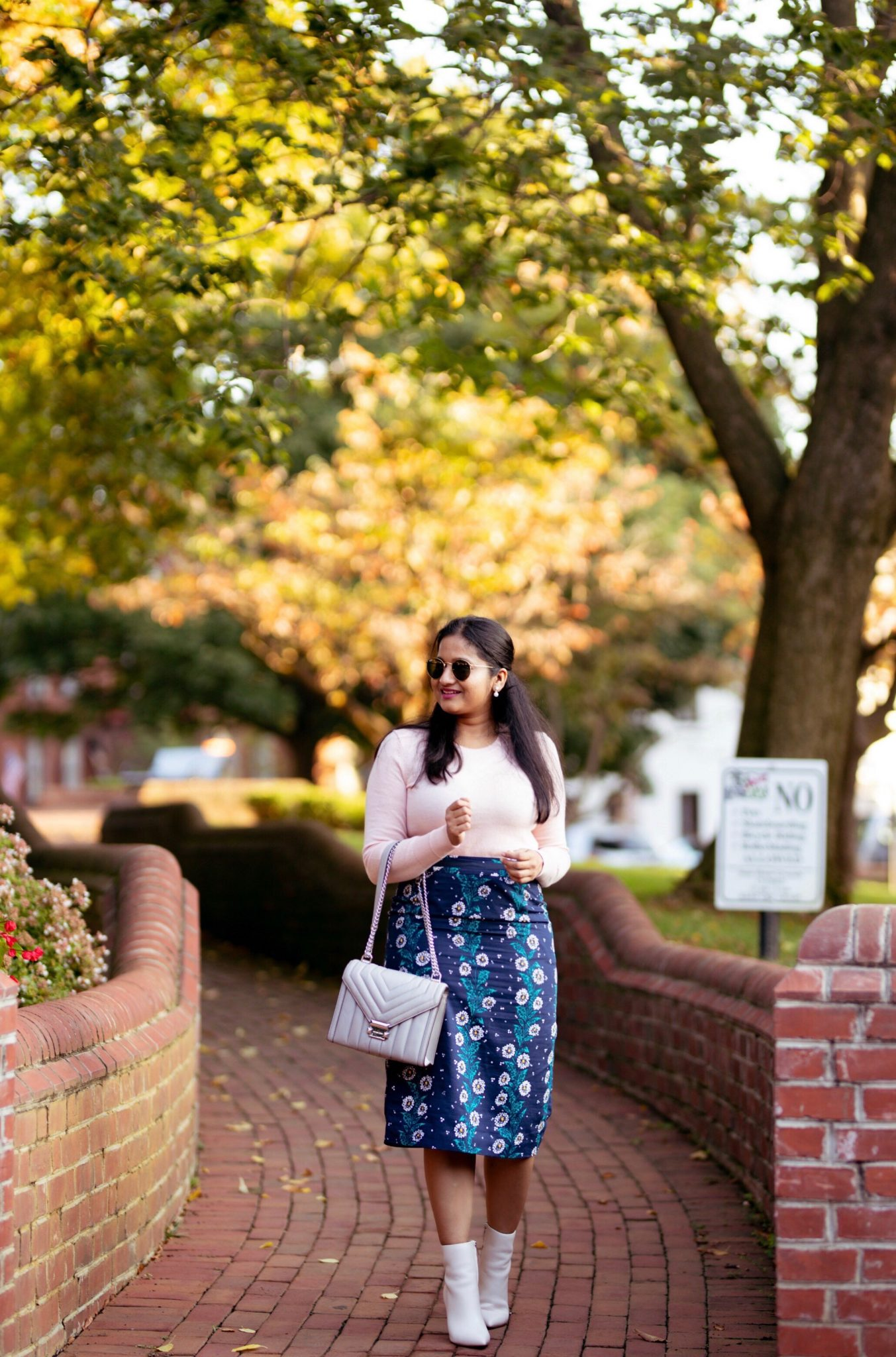 How to wear a printed pencil skirt in the Fall, styling tips featured by top US modest fashion blog, Dreaming Loud: image of a woman wearing Inheritco BROOKE Floral pencil skirt, Everlane The Cashmere Crew in pink, Marc Fisher LTD Ulani in ivory, purple wool coat