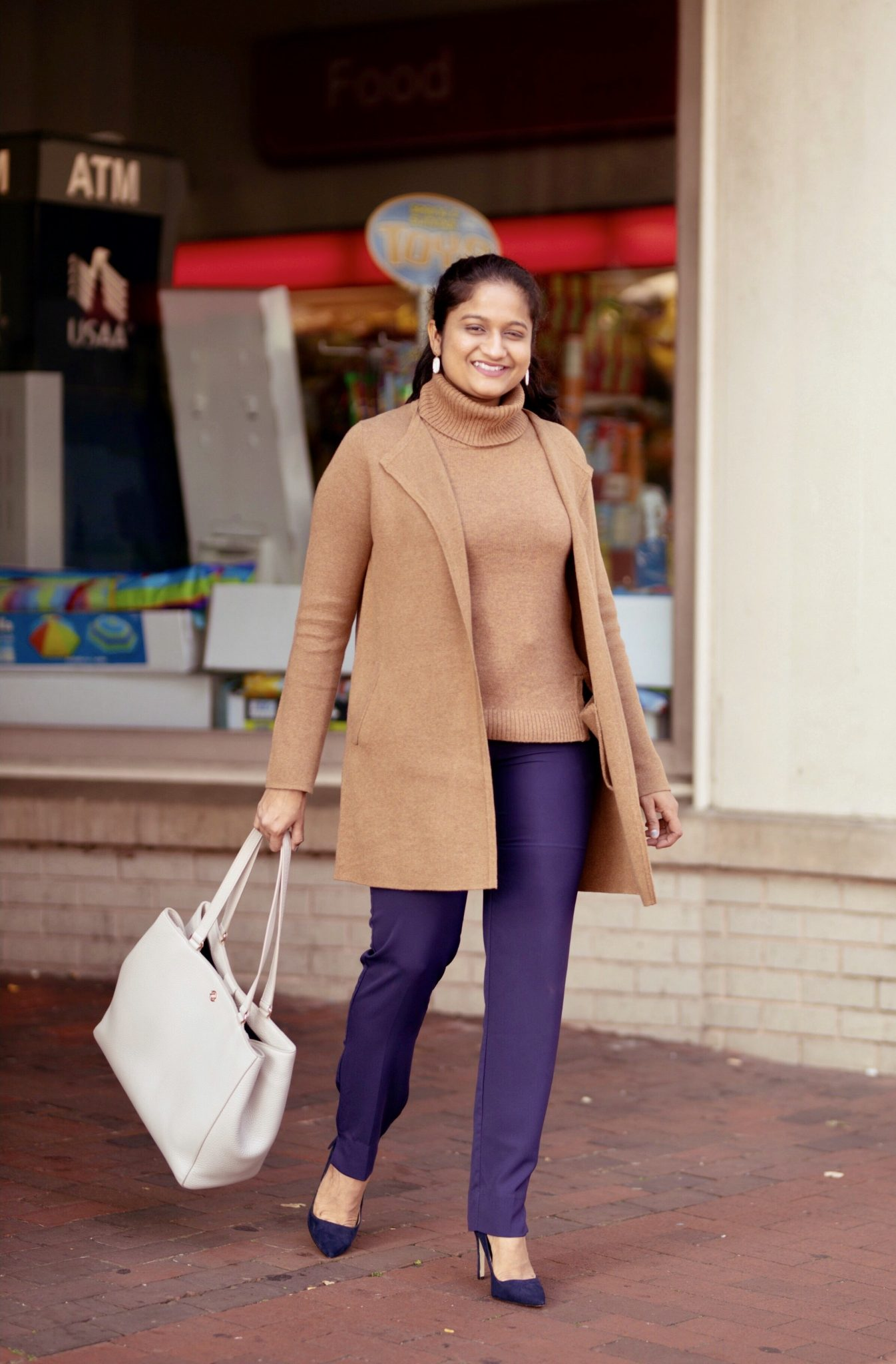 Camel Fashion favorites featured by top US fashion blog, Dreaming Loud: image of a woman wearing J.crew factory Vanessa sweater-jacket in camel, turtlrneck sweater tank, Aqua Slim Straight-Leg trousers, blue pumps, Dagne dover Allyn Tote