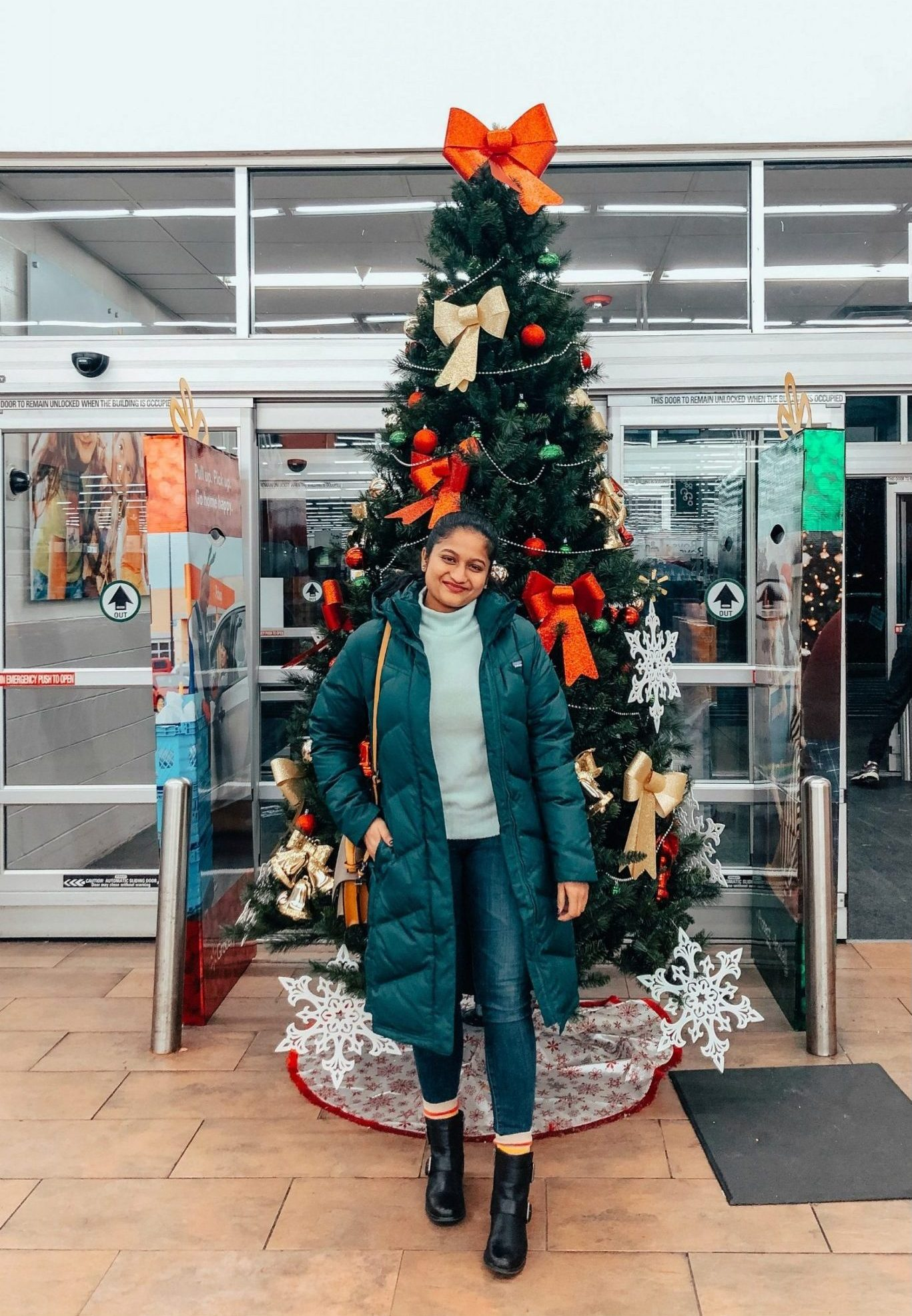 the Best Black Friday Sales and Deals for Clothes, Shoes and Accessories featured by top US modest fashion blog, Dreaming Loud: image of a woman wearing Patagonia Down With it Parka,J.crew Mockneck sweater in supersoft yarn,Aetrex boots,AG Farrah Ankle jeans