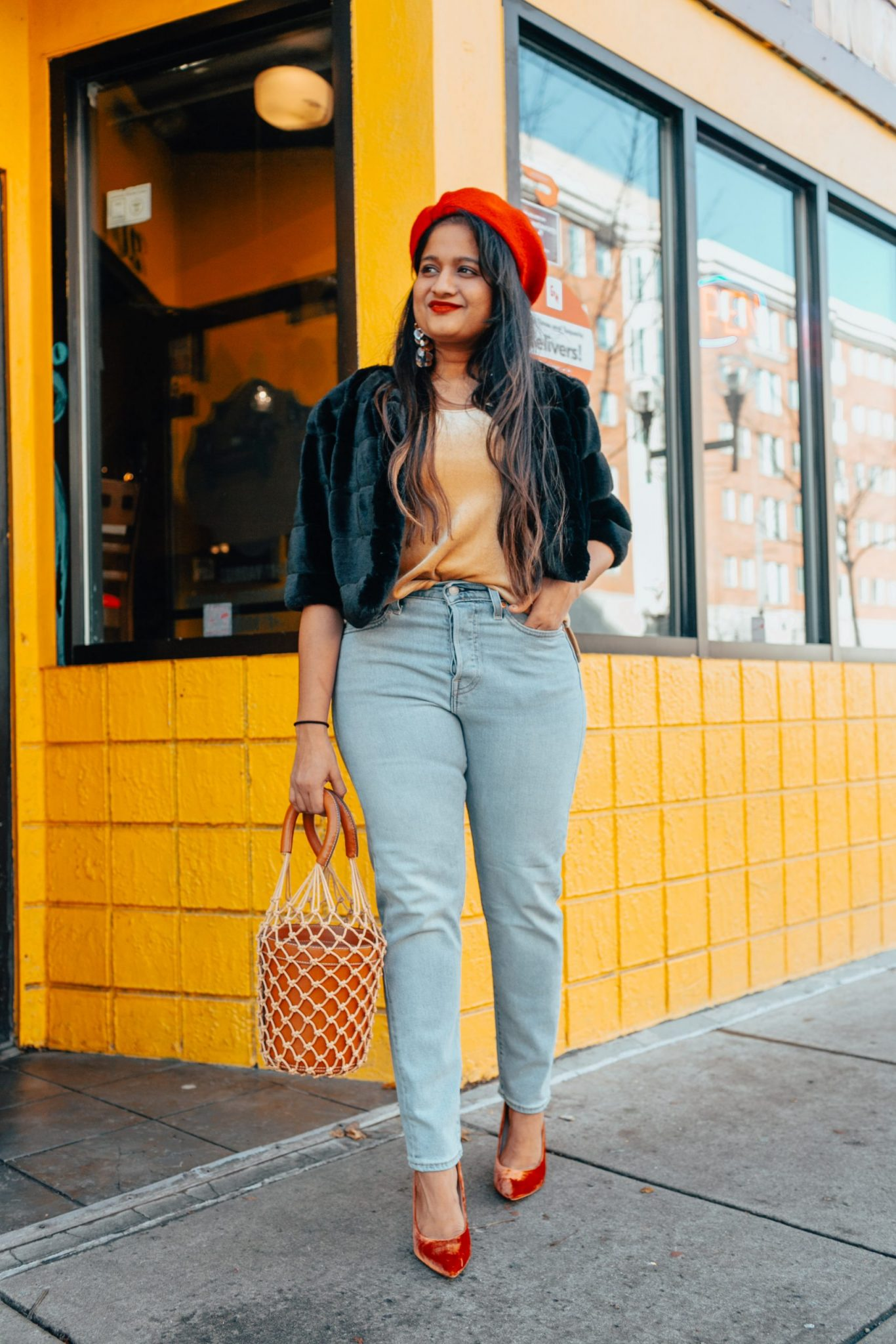 Holiday Style Essentials Under $50 featured by top US modest fashion blog, Dreaming Loud: image of a woman wearing a JCrew velvet cami, Levi's Wedgie Fit for Women, White House Black Market faux fur bolero, Banana Republic red beret, Marc Fisher pumps, and a Stand bucket bag.