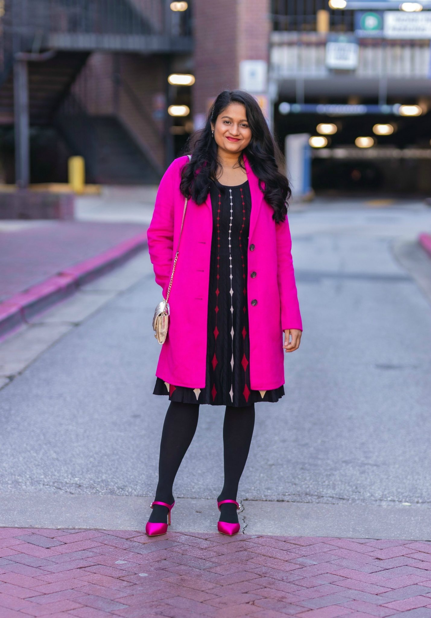 5 Cute Christmas Party Outfits by popular Maryland modest fashion blog, Dreaming Loud: image of a woman wearing Banana Republic topcoat in Hit pink,DANNY AND NICOLE diamond sweater dress,Fuchsia Pink Satin pumps, Rebecca minkoff Edie Chain Wallet.