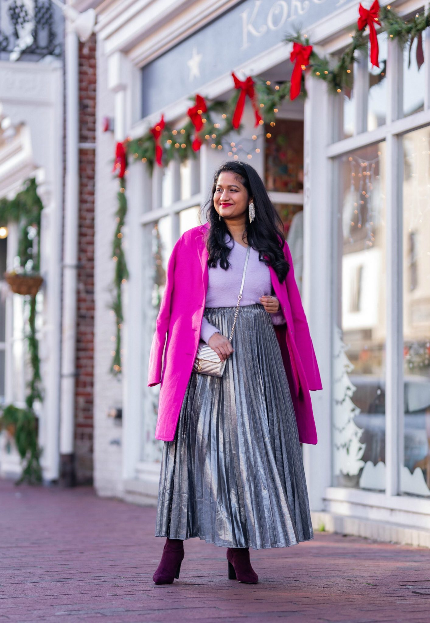 Amazon Holiday Fashion Favorites Under $50, featured by top US modest fashion blog, Dreaming Loud: image of a woman wearing Halogen Fuzzy V-Neck Sweater, amazon Silver pleated midi skirt,Banana Republic Topcoat in hot pink, Boden Burgundy knee high boots