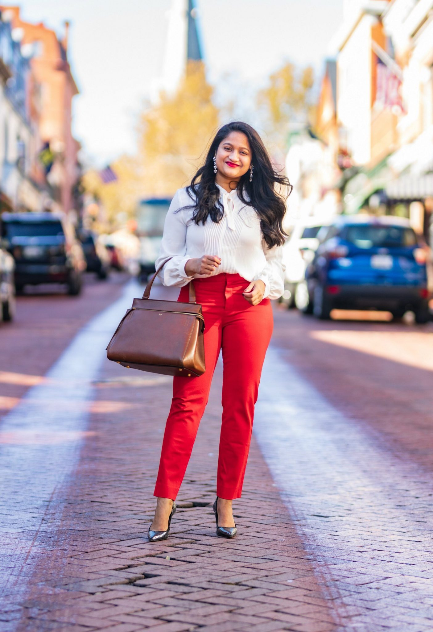5 Cute Christmas Party Outfits by popular Maryland modest fashion blog, Dreaming Loud: image of a woman wearing wearing Lauren Ralph Lauren Single Breasted Reefer Coat, Banana republic red sloan trousers.