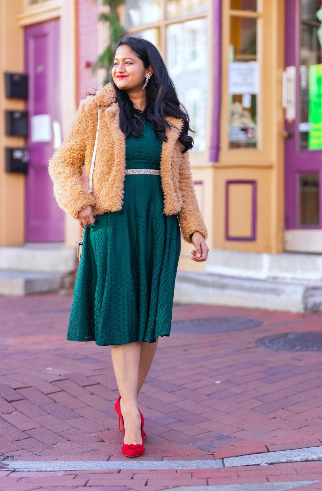 5 Cute Christmas Party Outfits by popular modest fashion blog, Dreaming Loud: image of a woman wearing Danny & Nicole green Lace Floral Fit & Flare Dress_ blanknyc faux fur teddy coat_Rhinestone Belt.
