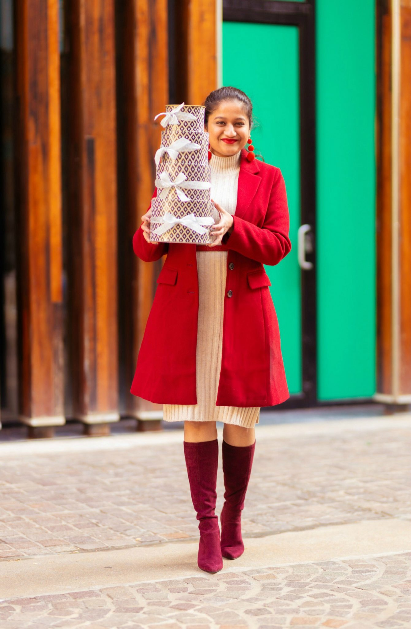 15 Cute Christmas Party Dresses Under $50 featured by top US modest fashion blog, Dreaming Loud: image of a woman wearing Nordstrom BPRibbed Long Sleeve Sweater Dress, Allegra K Women's Notched Lapel Single Breasted coat, Ralph Lauren polo red belt, bode knee high boots