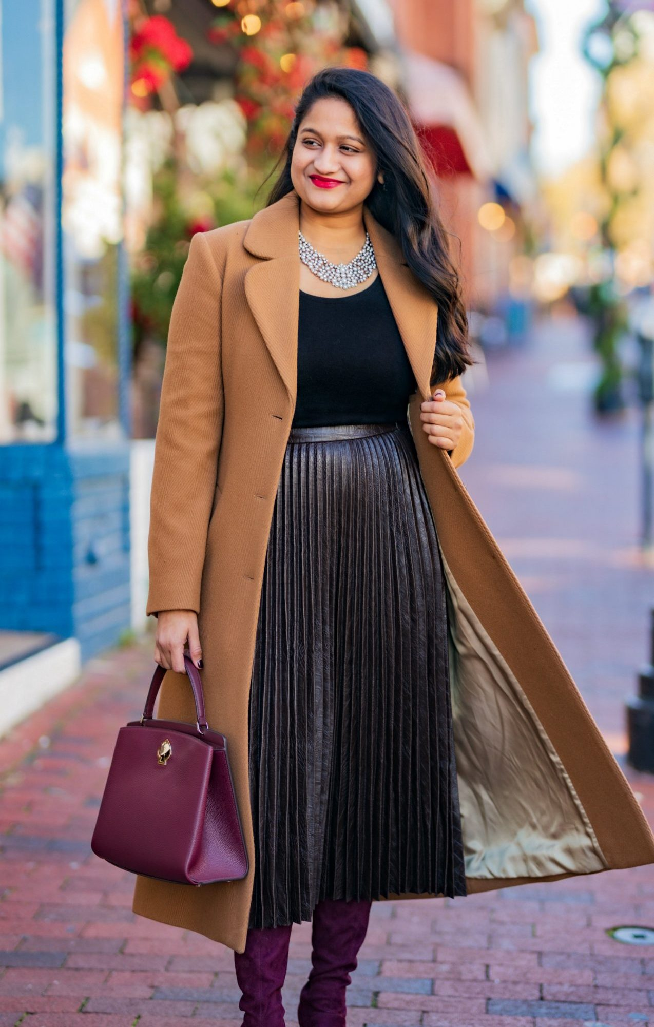 10 Winter Essentials For a Cozy Look featured by top Maryland modest fashion blogger, Dreaming Loud: image of a woman wearing and other stories A-Line Wool Blend Belted Coat, Madewell Puff-Sleeve Scoopneck Top,Atlantic-Pacific Pleated Croc Faux Leather Midi Skirt, Boden burgundy knee high boots,Kate Spade Romy Leather Turnlock Satchel Bag.