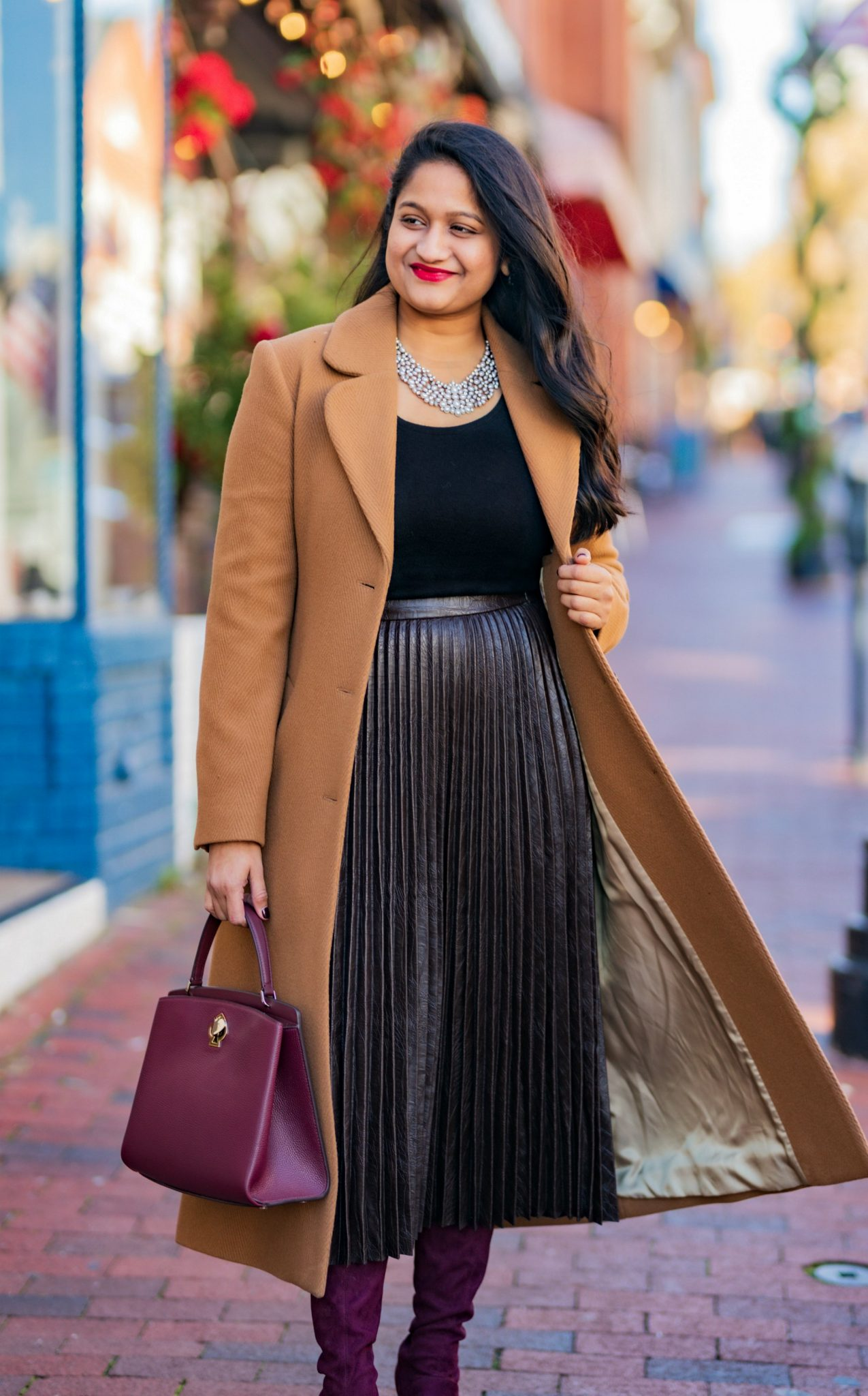 5 Cute Christmas Party Outfits by popular Maryland modest fashion blog, Dreaming Loud: image of a woman wearing and other stories A-Line Wool Blend Belted Coat, Madewell Puff-Sleeve Scoopneck Top,Atlantic-Pacific Pleated Croc Faux Leather Midi Skirt, burgundy knee high boots.