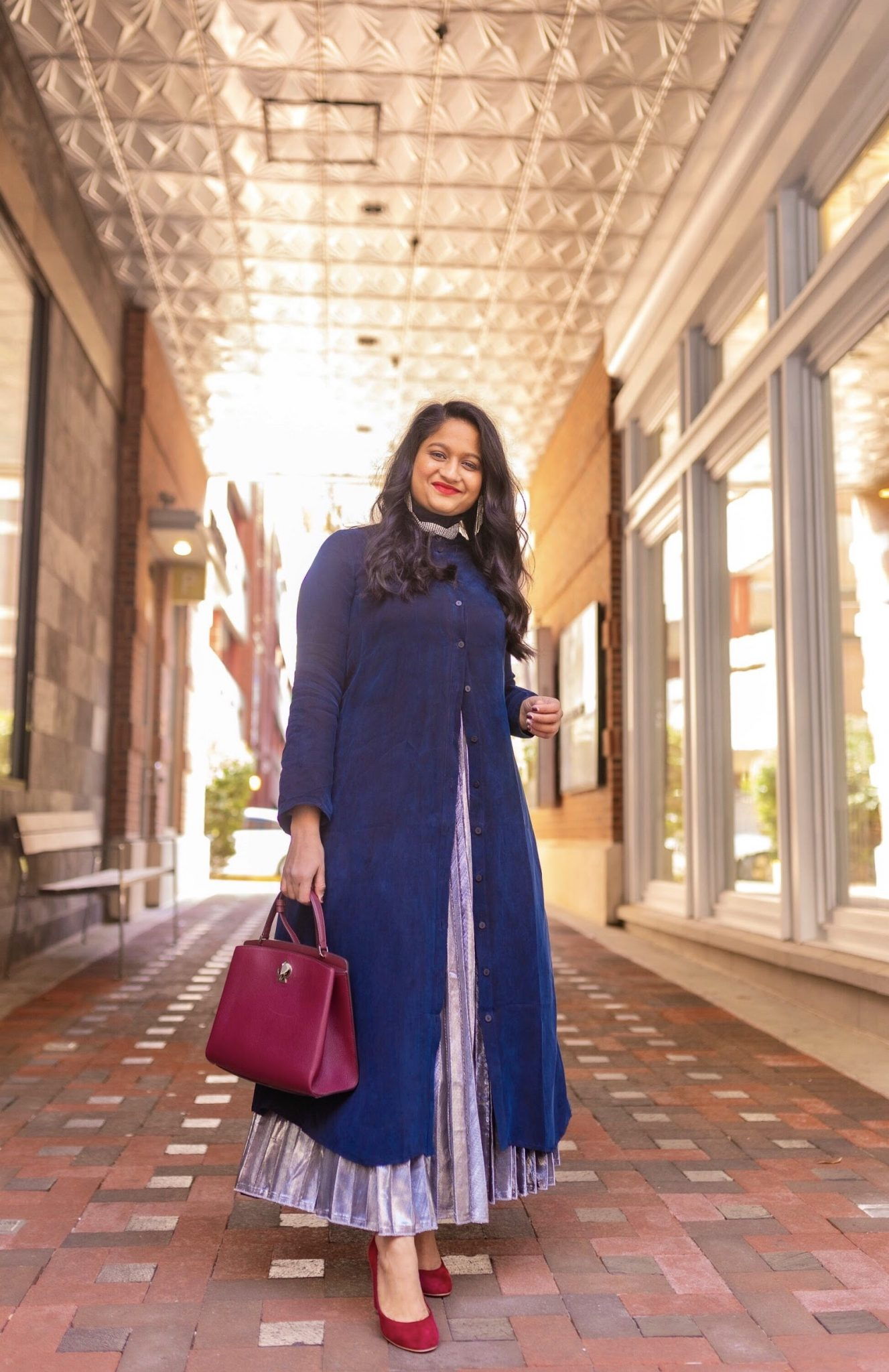 How to Style The Frock NYC Iconic Shirt Dress featured by top US modest fashion blog, Dreaming Loud: image of a woman wearing a shirt dress as a tunic-The froknyc Iconic Dress in navy, Silver pleated skirt, kate spade Ro mySatchel Bag 2