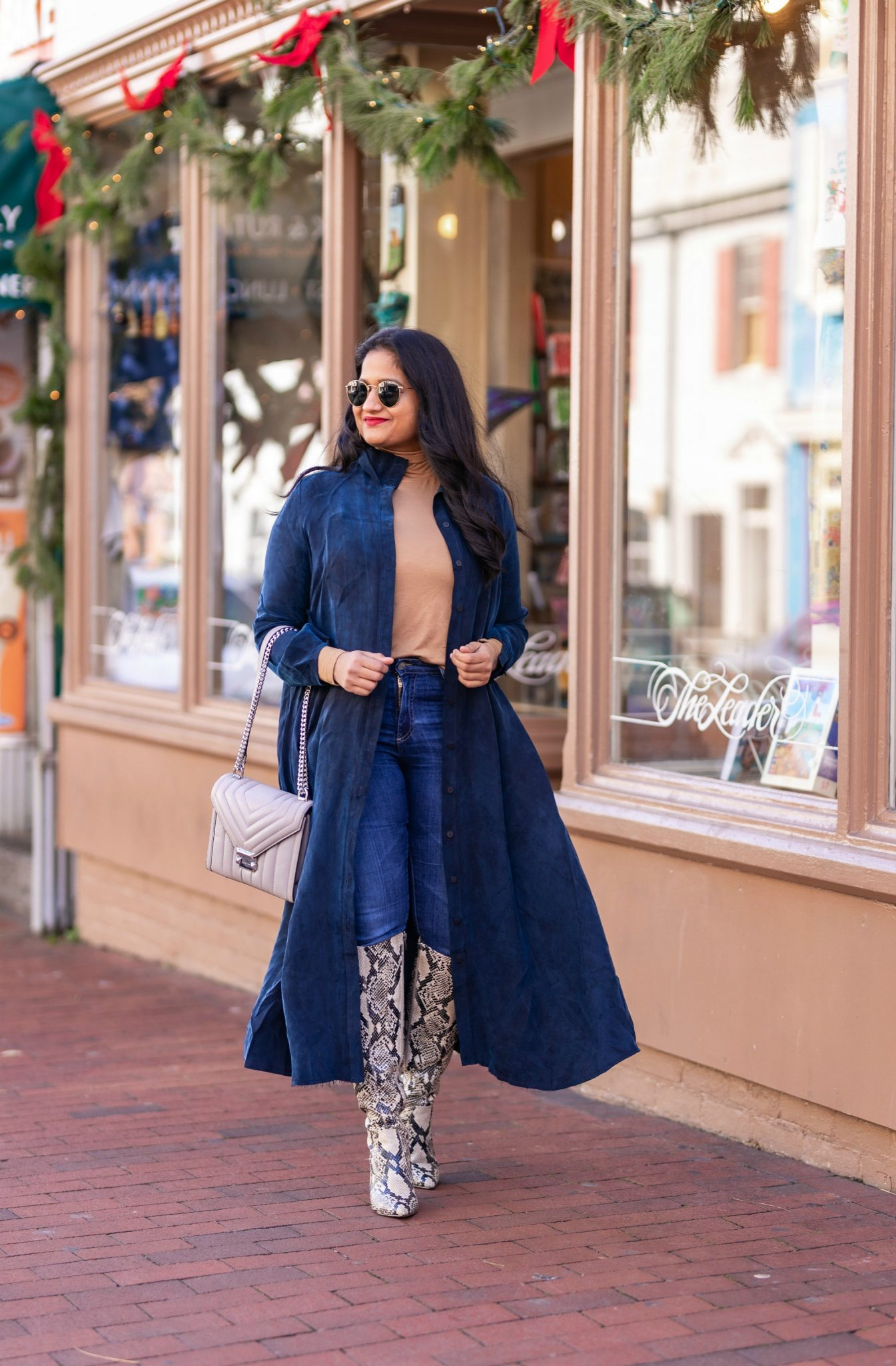 How to Style The Frock NYC Iconic Shirt Dress featured by top US modest fashion blog, Dreaming Loud: image of a woman wearing a Shirt dress as long jacket-Wearing Frock NYC iconic shirt dress,polar tee, Ag farrah jeans,marc fisher retie snake print boots