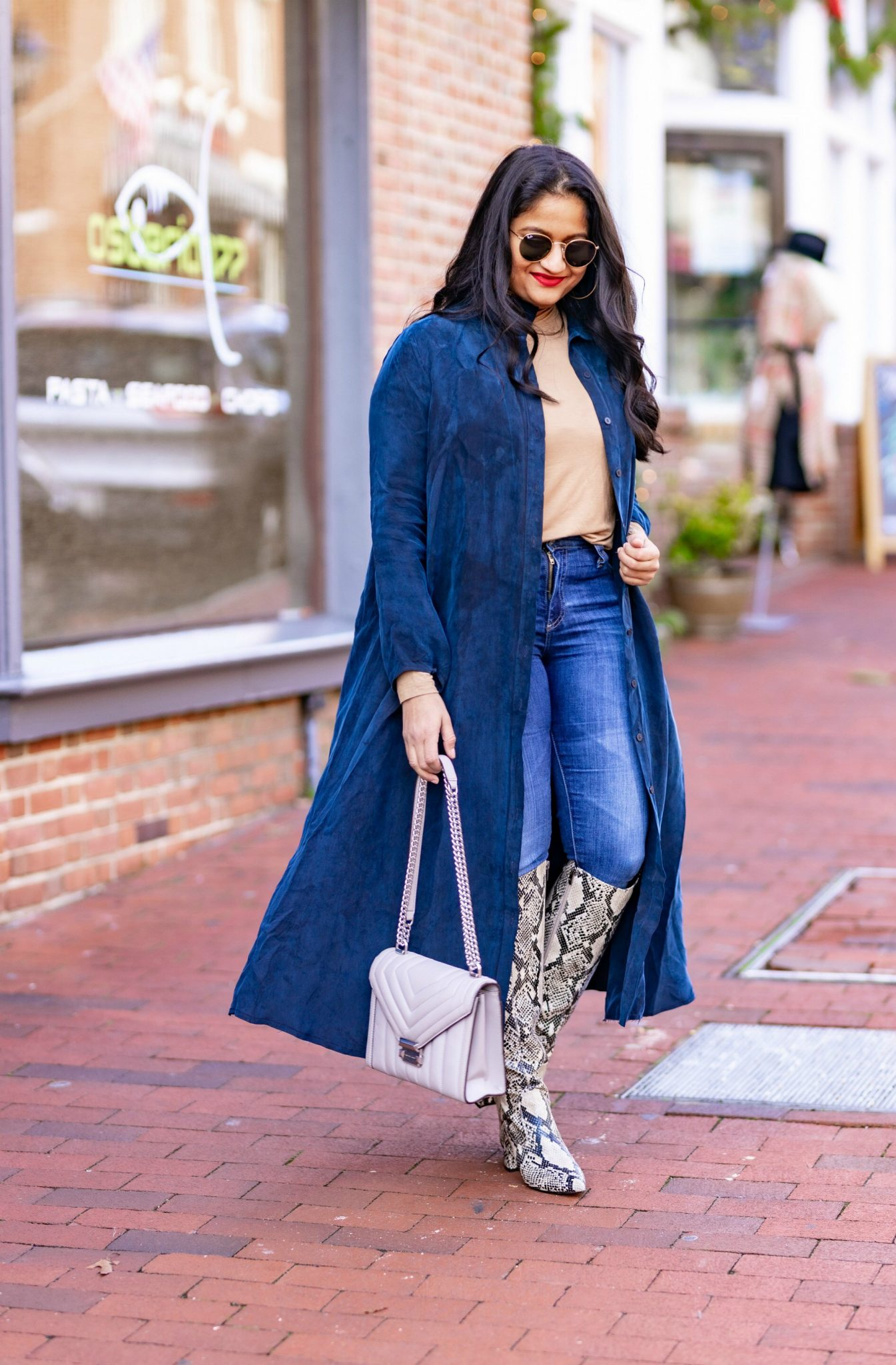 How to Style The Frock NYC Iconic Shirt Dress featured by top US modest fashion blog, Dreaming Loud: image of a woman wearing a Shirt dress as long jacket-Wearing Frock NYC iconic shirt dress,polar tee, Ag farrah jeans,marc fisher retie snake print boots1