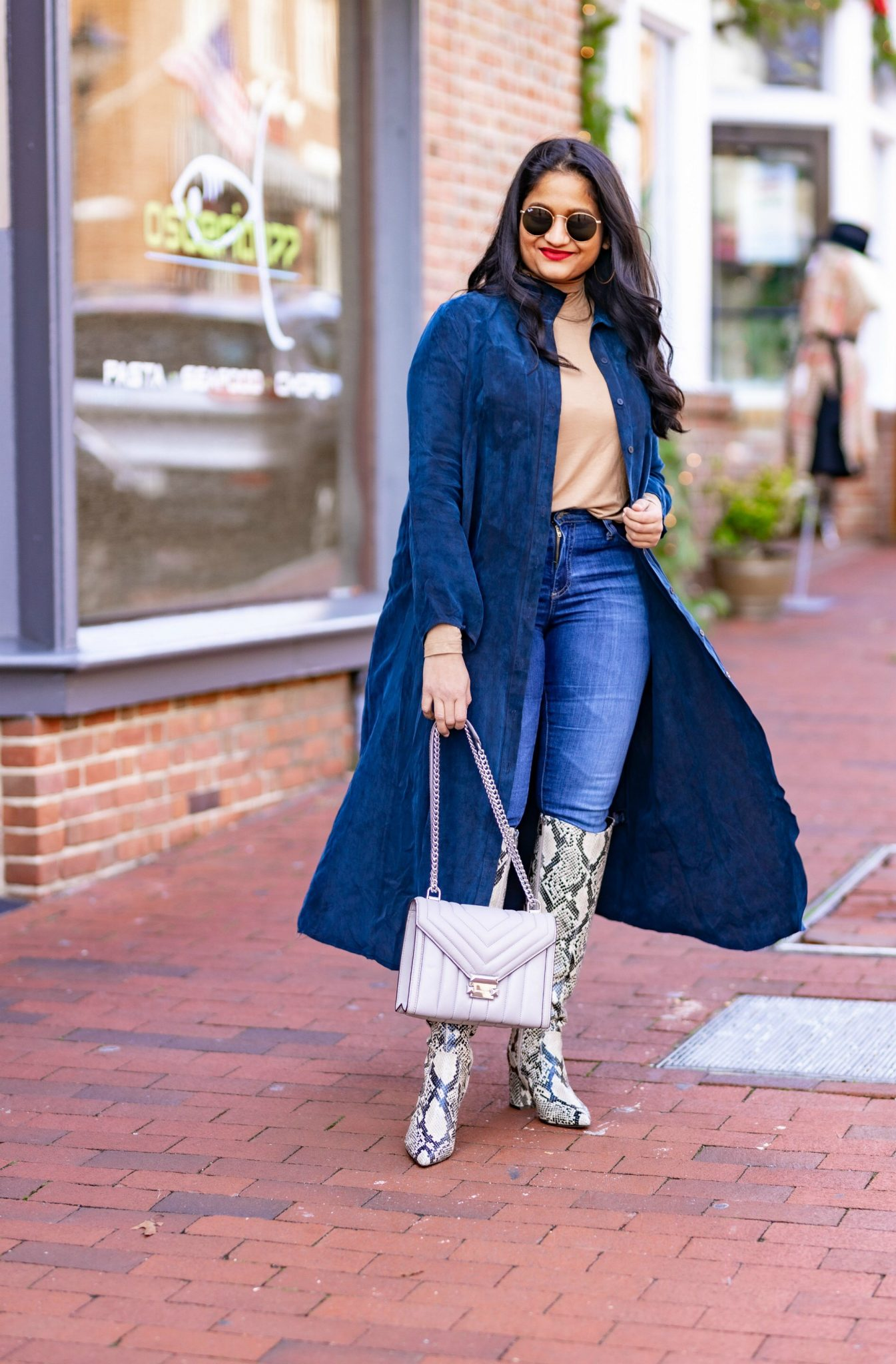 How to Style The Frock NYC Iconic Shirt Dress featured by top US modest fashion blog, Dreaming Loud: image of a woman wearing a Shirt dress as long jacket-Wearing Frock NYC iconic shirt dress,polar tee, Ag farrah jeans,marc fisher retie snake print boots2