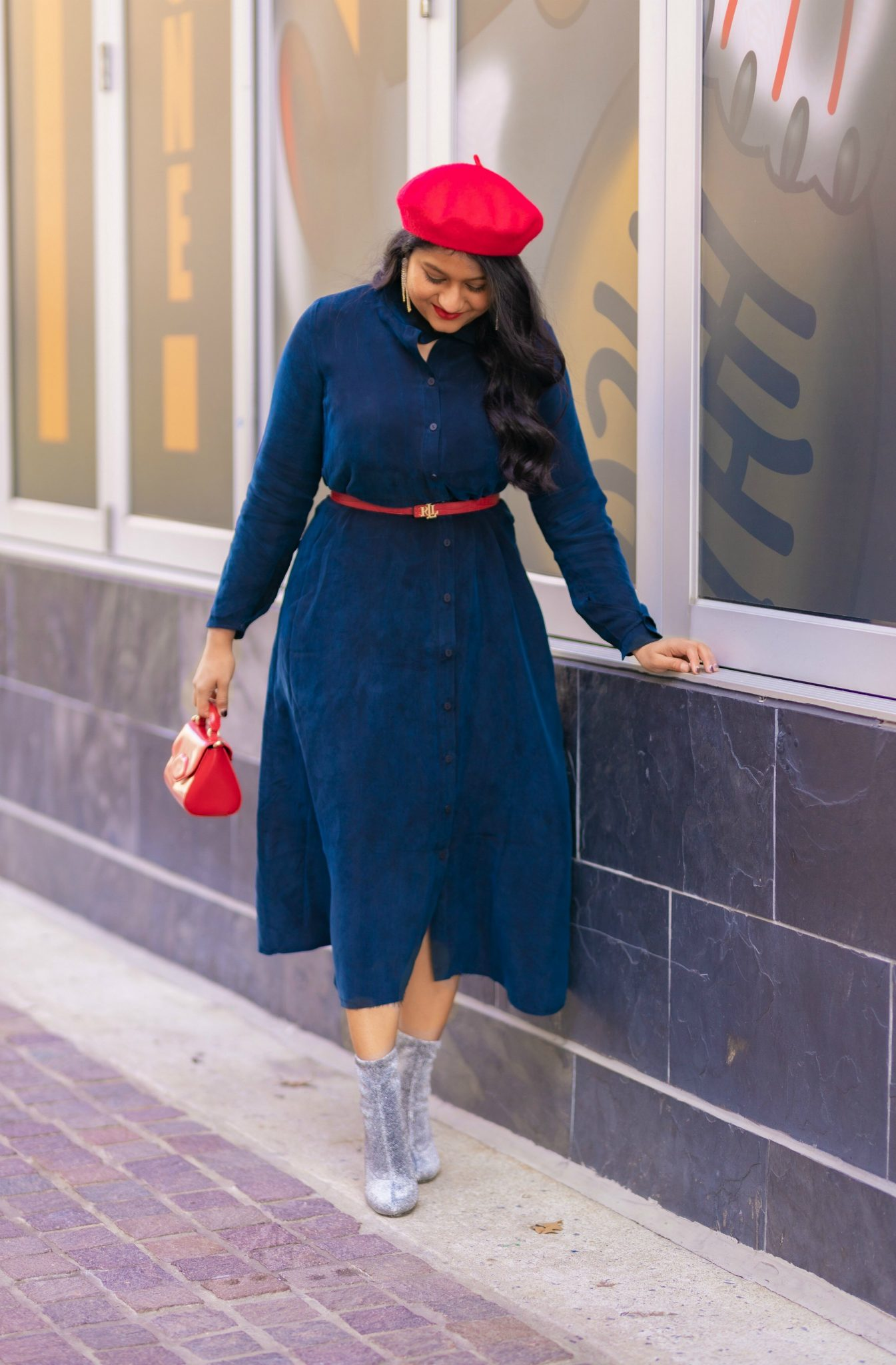 How to Style The Frock NYC Iconic Shirt Dress featured by top US modest fashion blog, Dreaming Loud: image of a woman wearing a shirt dress with a belt-Wearing Frock nyc iconic shirt dress, Ralph lauren polo red belt, sequin boots, lulu guinness lip bag, red beret 1