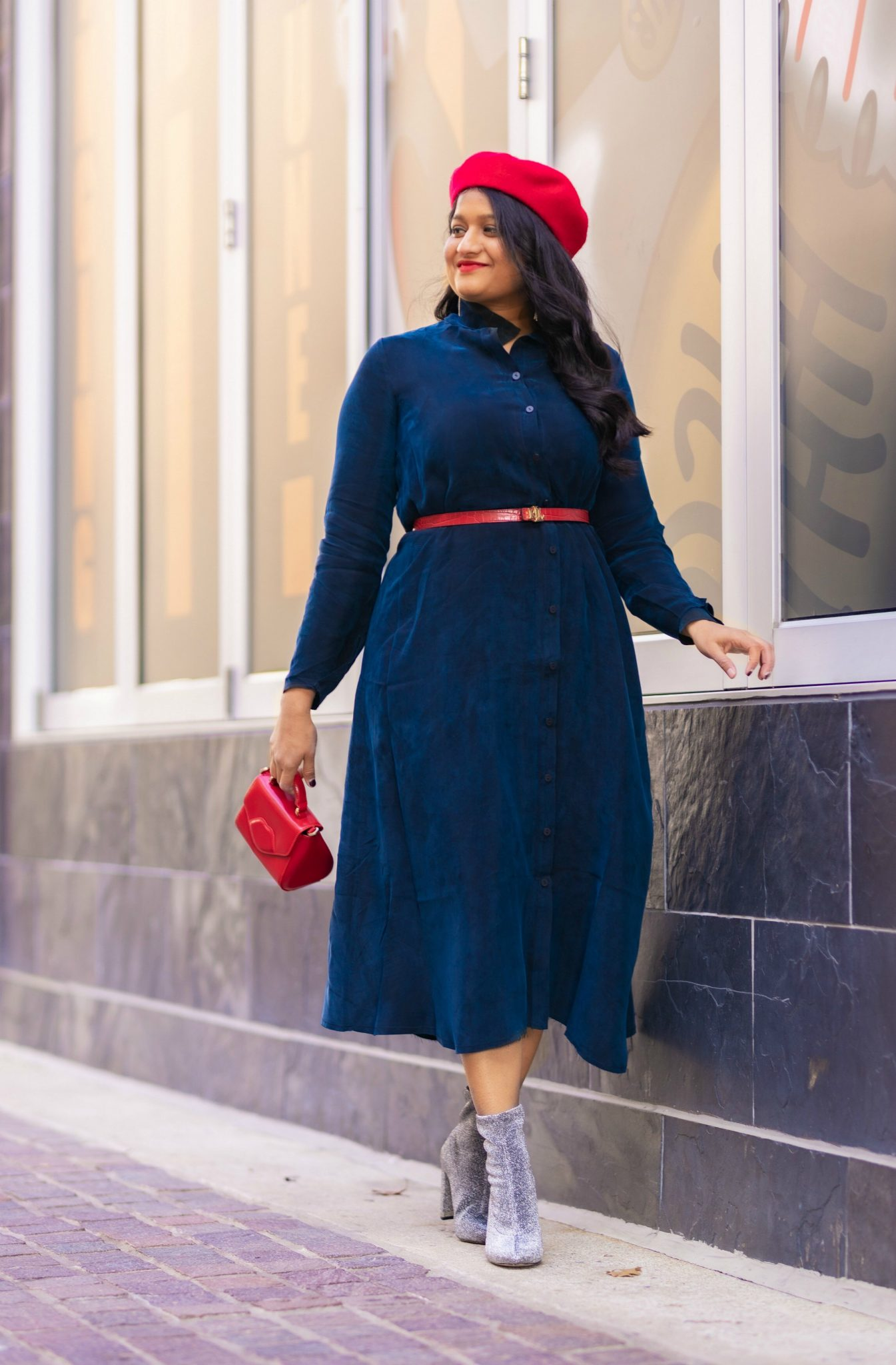 How to Style The Frock NYC Iconic Shirt Dress featured by top US modest fashion blog, Dreaming Loud: image of a woman wearing a Shirt dress with a belt-Wearing Frock nyc iconic shirt dress, Ralph lauren polo red belt, sequin boots, lulu guinness lip bag, red beret