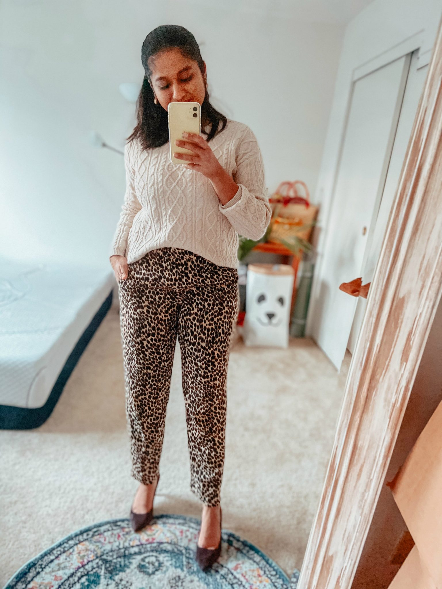 How to Wear Leopard Print Pants for the Office featured by top US modest fashion blog, Dreaming Loud: image of a woman Wearing J.crew factory Leopard print Jamie pant, white cable knit sweater, Banana republic madison 12 hour pumps