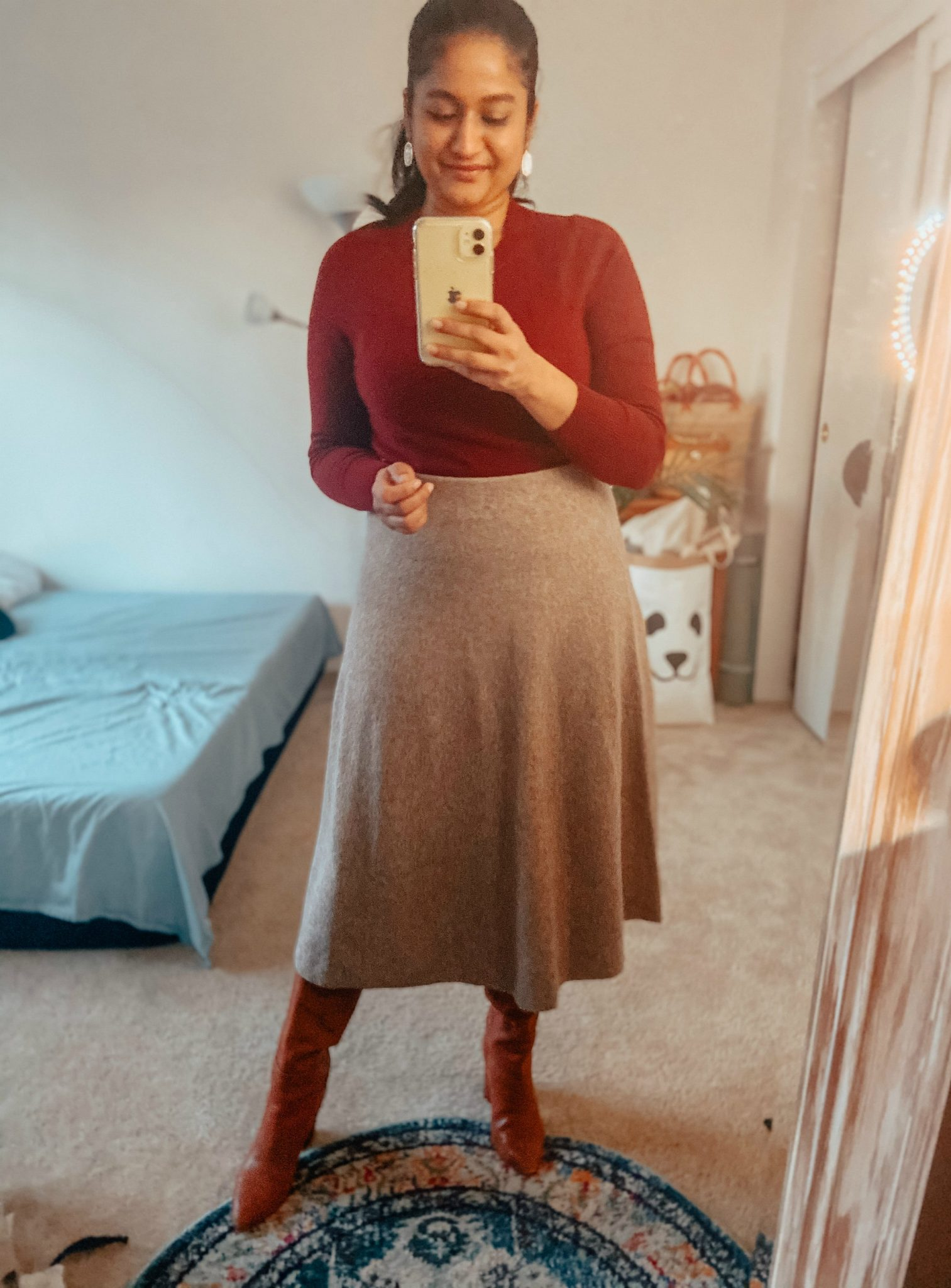Uniqlo Wool Skirt Outfit featured by top US modest fashion blog, Dreaming Loud: image of a woman Wearing Uniqlo flare wool skirt, jcrew cashmere crewneck sweater, brown leather knee high boots, leith longline cardigan.