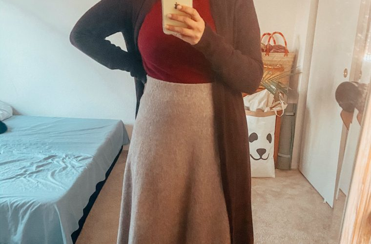 Uniqlo Wool Skirt Outfit featured by top US modest fashion blog, Dreaming Loud: image of a woman Wearing Uniqlo flare wool skirt, jcrew cashmere crewneck sweater, brown leather knee high boots, leith longline cardigan