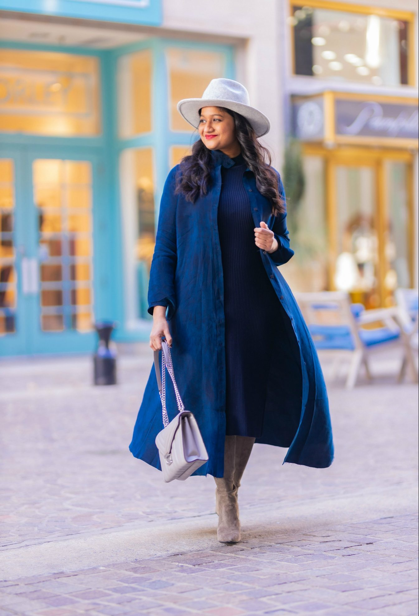 10 Winter Essentials For a Cozy Look featured by top Maryland modest fashion blogger, Dreaming Loud: image of a woman Wearing the NYC frock Iconic shirt dress, amazon fashion lark and ro sweater dress, grey otk boots, lack of color grey fedora hat, MK whitney satchel