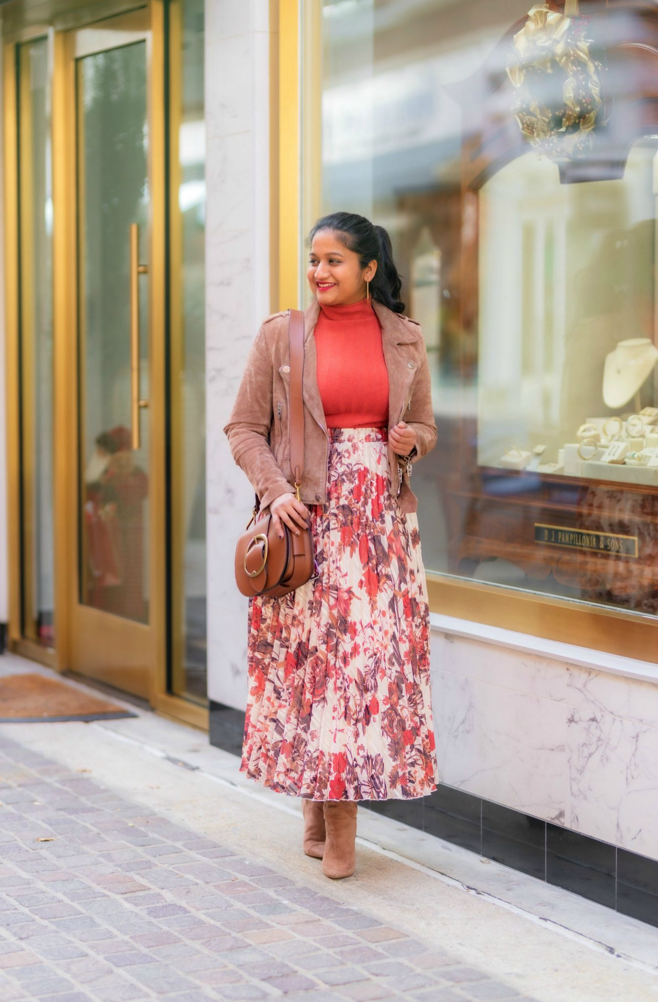 The Importance of Setting Intentions to Achieve your Goals and Resolutions, thoughts featured by top US lifestyle blog, Dreaming Loud: image of a woman wearing hm pleated floral skirt, blank nyc suede moto jacket Sam edelman Francia Stiletto Knee High Boot 2