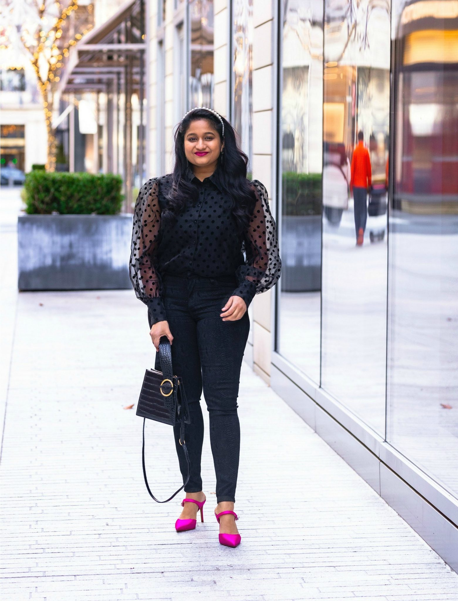 How to Be a Productive Blogger and Influencer featured by top US fashion blogger and influencer Surekha of Dreaming Loud: image of a woman wearing Mango Puffed sleeve shirt_ Joes jeans high rise snake print jean_ hot pink heels_ Olive and Piper pearl headband