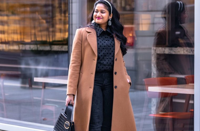 How to Be a Productive Blogger and Influencer featured by top US fashion blogger and influencer Surekha of Dreaming Loud: image of a woman Wearing And other stories Camel coat_ Mango Puffed sleeve shirt_ Joes jeans high rise snake print jean_ hot pink heels_ Olive and Piper pearl headband