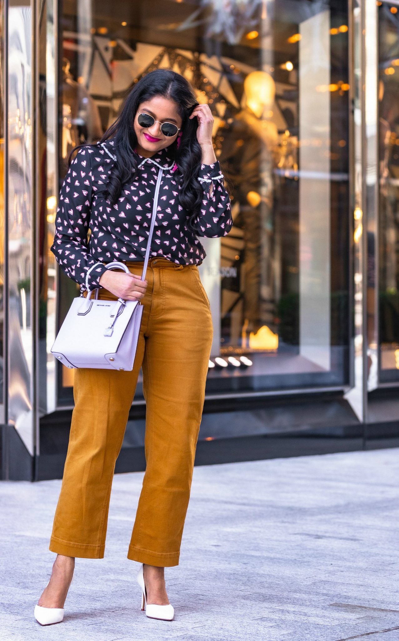 Allegra K Heart Print Blouse styled for for Valentine's Day by top US modest fashion blog, Dreaming Loud: image of a woman wearing Allegra K heart print blouse, everlane straight leg crop,mango belted wool coat in beige, mk mercer bag