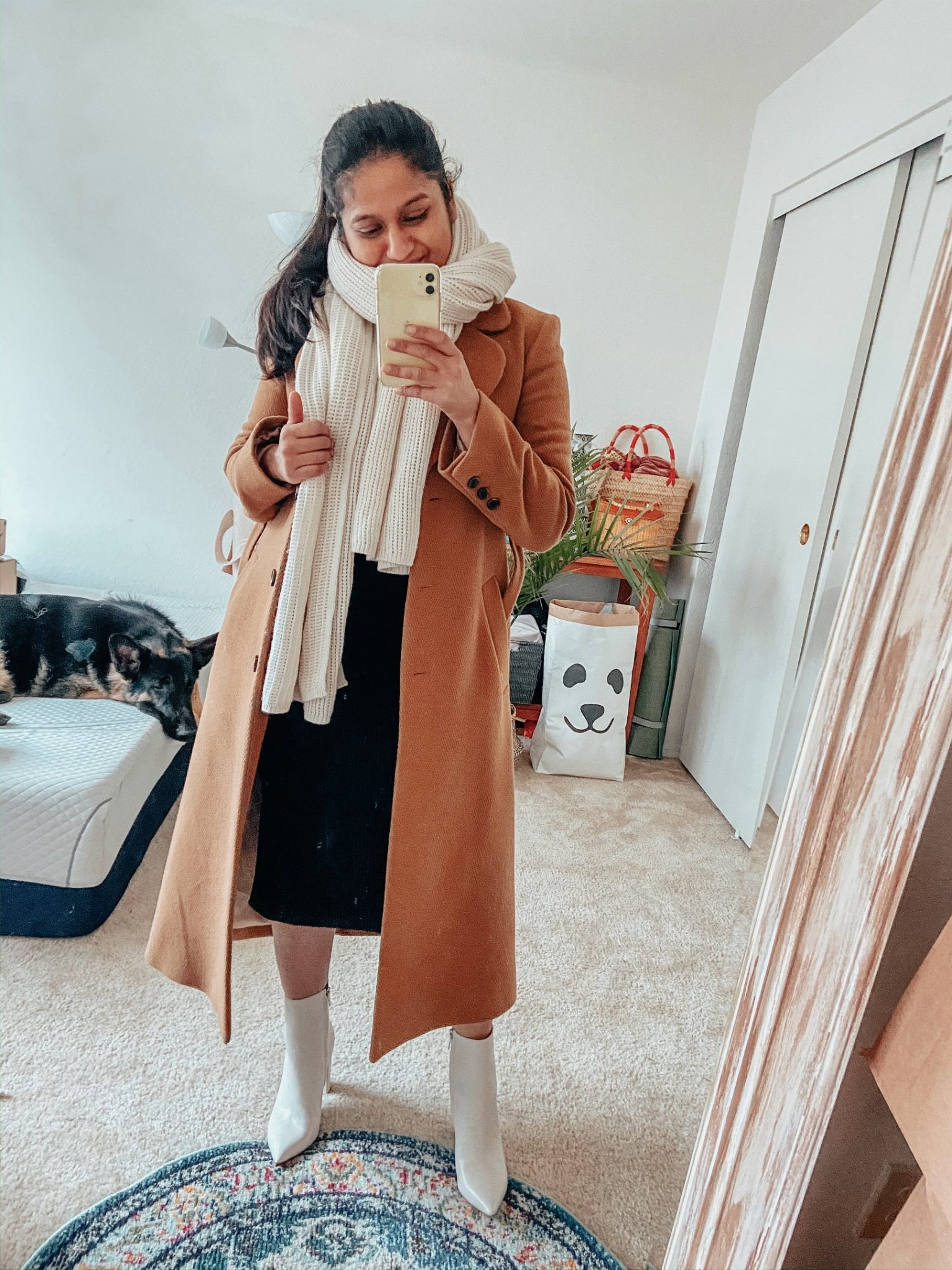 Camel Coat Outfits for Work styled by top US modest fashion blog, Dreaming Loud: image of a woman wearing Amazon fashion Lark and ro sweater dress, and other stories A-line camel coat, Club monaco cashmere scarf, Marc fisher Ulani boots in white