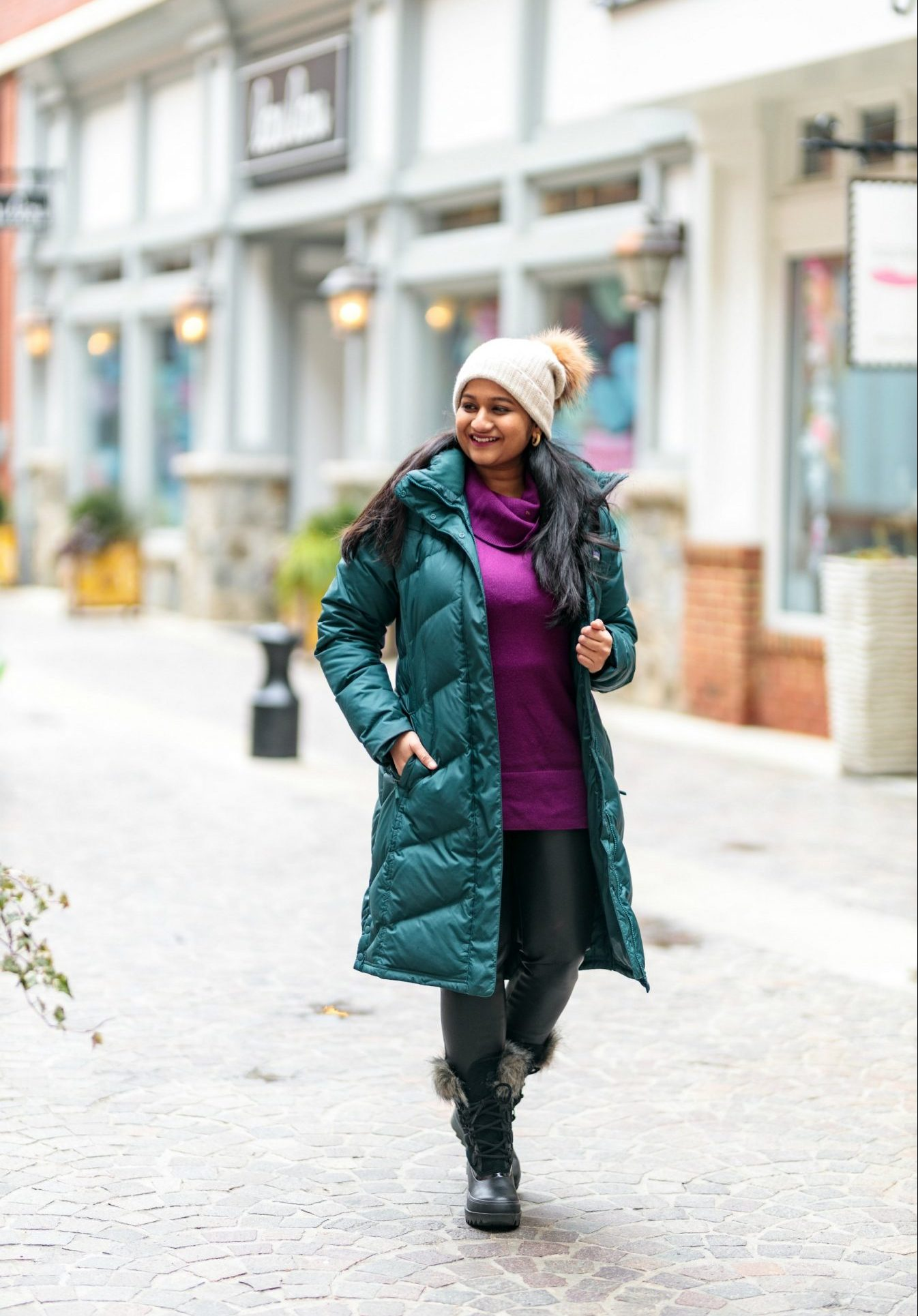 Patagonia Down with IT Parka styled by top US modest fashion blog, Dreaming Loud: Wearing Loft Cowl Neck Tunic Sweater, Free people Fringe Blanket scarf, faux leather legging, Sorel Arctic Next boots 1