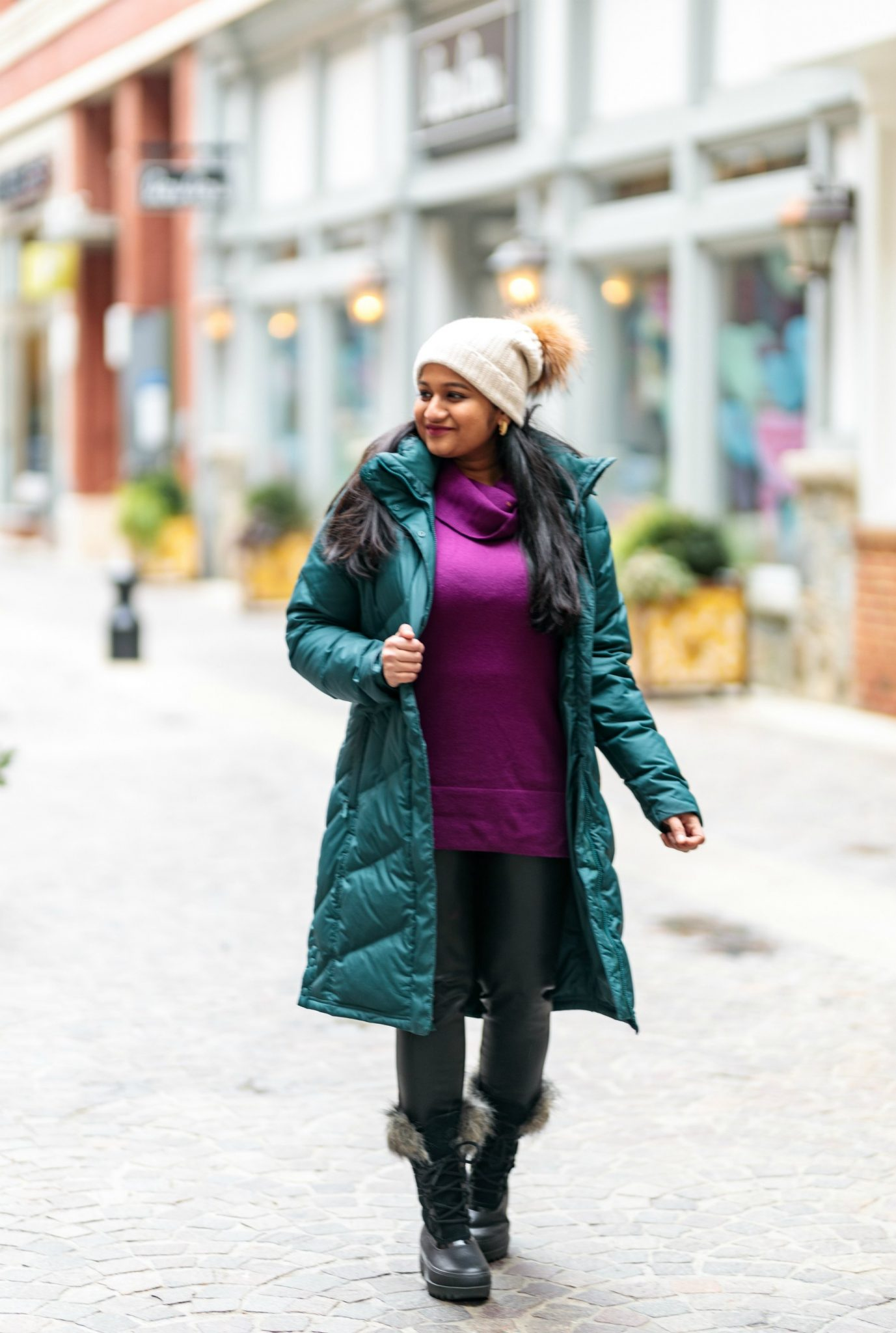 Winter Outfit with Patagonia Down Parka and Sorel Next Snow Boots featured by top US fashion blog, Dreaming Loud picture of a women Wearing Loft Cowl Neck Tunic Sweater, Free people Fringe Blanket scarf, faux leather legging, Sorel Arctic Next boots 2