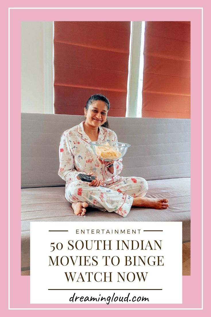 50 Latest South Indian Movies to Binge-Watch on Amazon Prime and Netflix featured by top US Lifestyle blog, Dreaming Loud | Best South India Movies to Watch by popular Maryland lifestyle blog, Dreaming Loud: Pinterest image of a woman sitting on a couch, wearing floral pajamas and holding a bowl of chips.