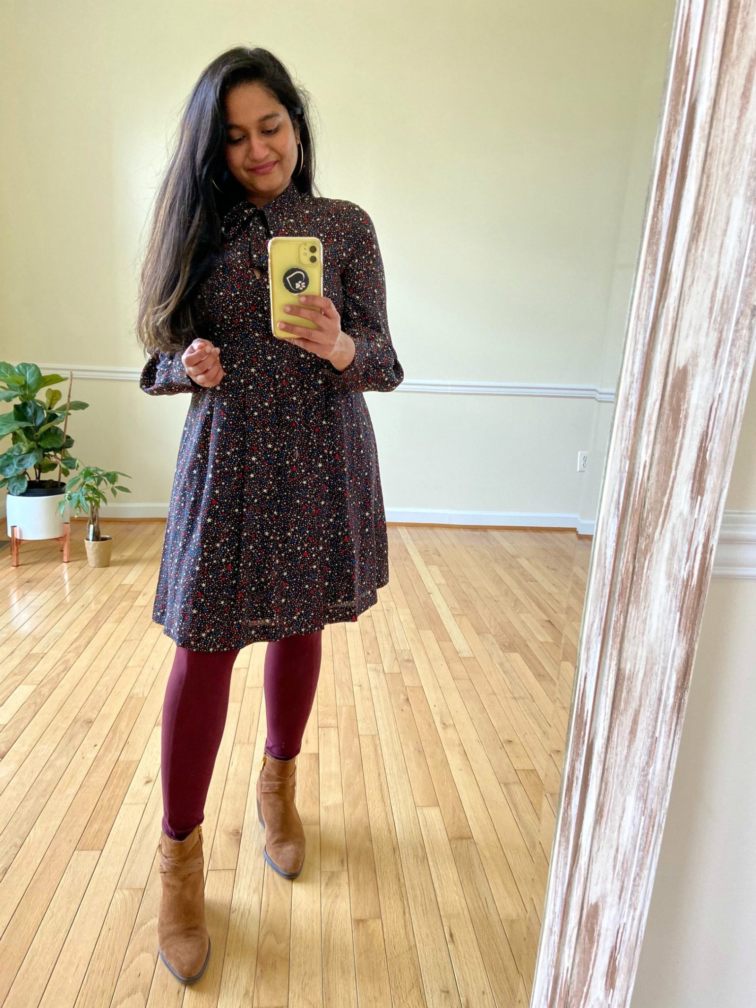 image of a woman How to wear Burgundy leggings All Through the Year (practical outfit ideas): featured by top US lifestyle blog, Dreaming Loud: image of a woman wearing Madewell printed dress, Naturalizer Fenya Booties | Burgundy Leggings Outfit by popular Michigan fashion blog, Dreaming Loud: image of a woman wearing Amazon Fengbay High Waist Yoga Pants with Pockets, Madewell dress, Macys Naturalizer Fenya Booties, and Amazon Huge Gold Hoop Earrings.