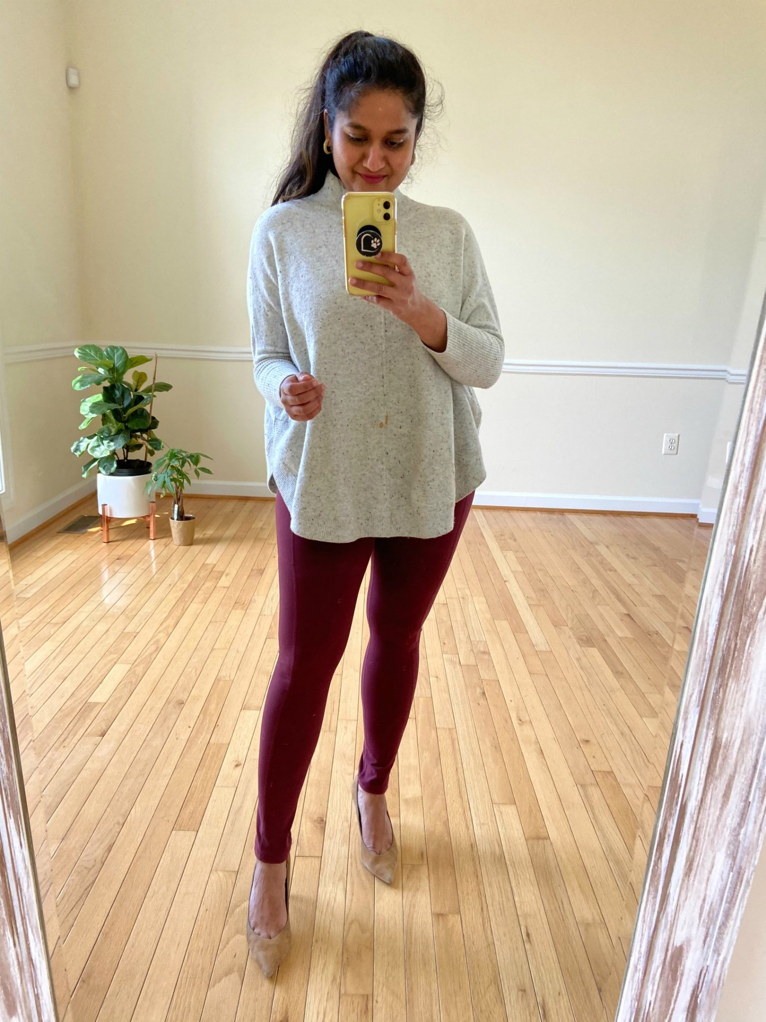 How to Wear Burgundy/Maroon Leggings All through the Year (Practical Outfit Ideas) featured by top US lifestyle blog, Dreaming Loud: image of a woman wearing Loft poncho sweater, Amazon burgundy leggings, Banana Republic 12 hour pumps | Burgundy Leggings Outfit by popular Michigan fashion blog, Dreaming Loud: image of a woman wearing a Loft FLECKED MOCK NECK PONCHO SWEATER, Amazon Fengbay High Waist Yoga Pants with Pockets, Banana Republic Madison 12-Hour Pump, and BaubleBar MARCIELLA HOOP EARRINGS.