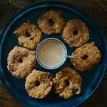 Pesara Garelu Recipe – Green Moong Vada featured by Top US Vegan Food blogger dreaming loud1 | Pesara Garelu Recipe by popular Maryland lifestyle blog, Dreaming Loud: image of Pesara Garelu and masala chai on a plate.